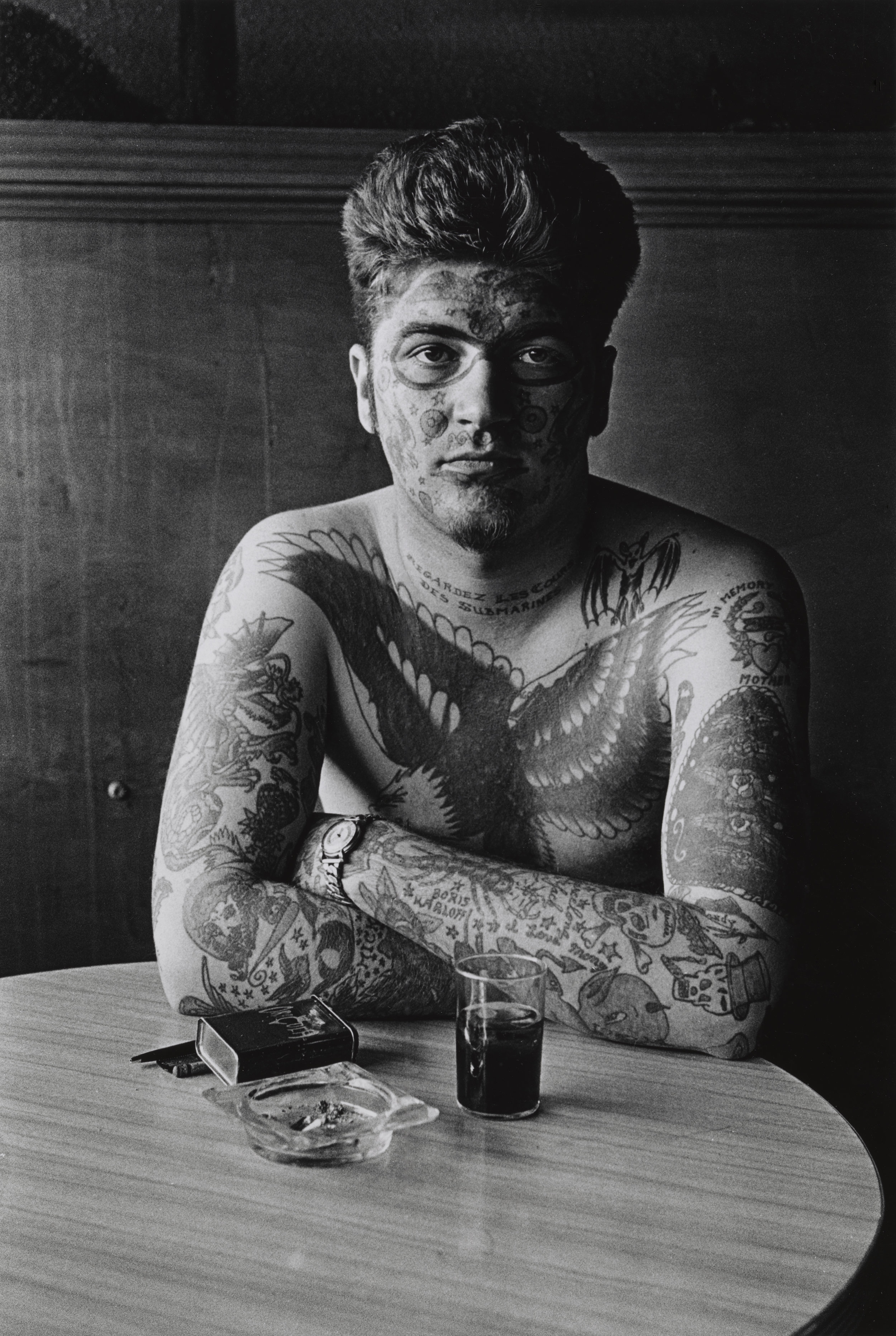 Jack Dracula at a bar, New London, 1961 -  Copyright © The Estate of Diane Arbus, LLC. All Rights Reserved.