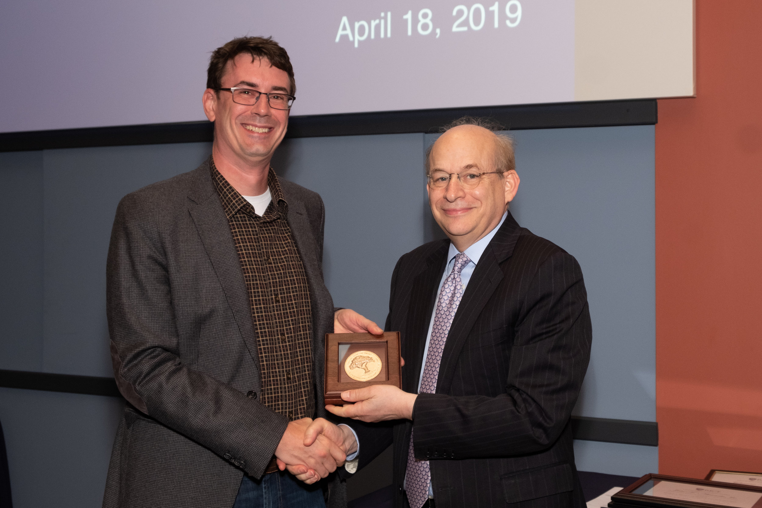 President Leebron & Matthew Bennett, Charles W. Duncan Achievement Award for Outstanding Faculty