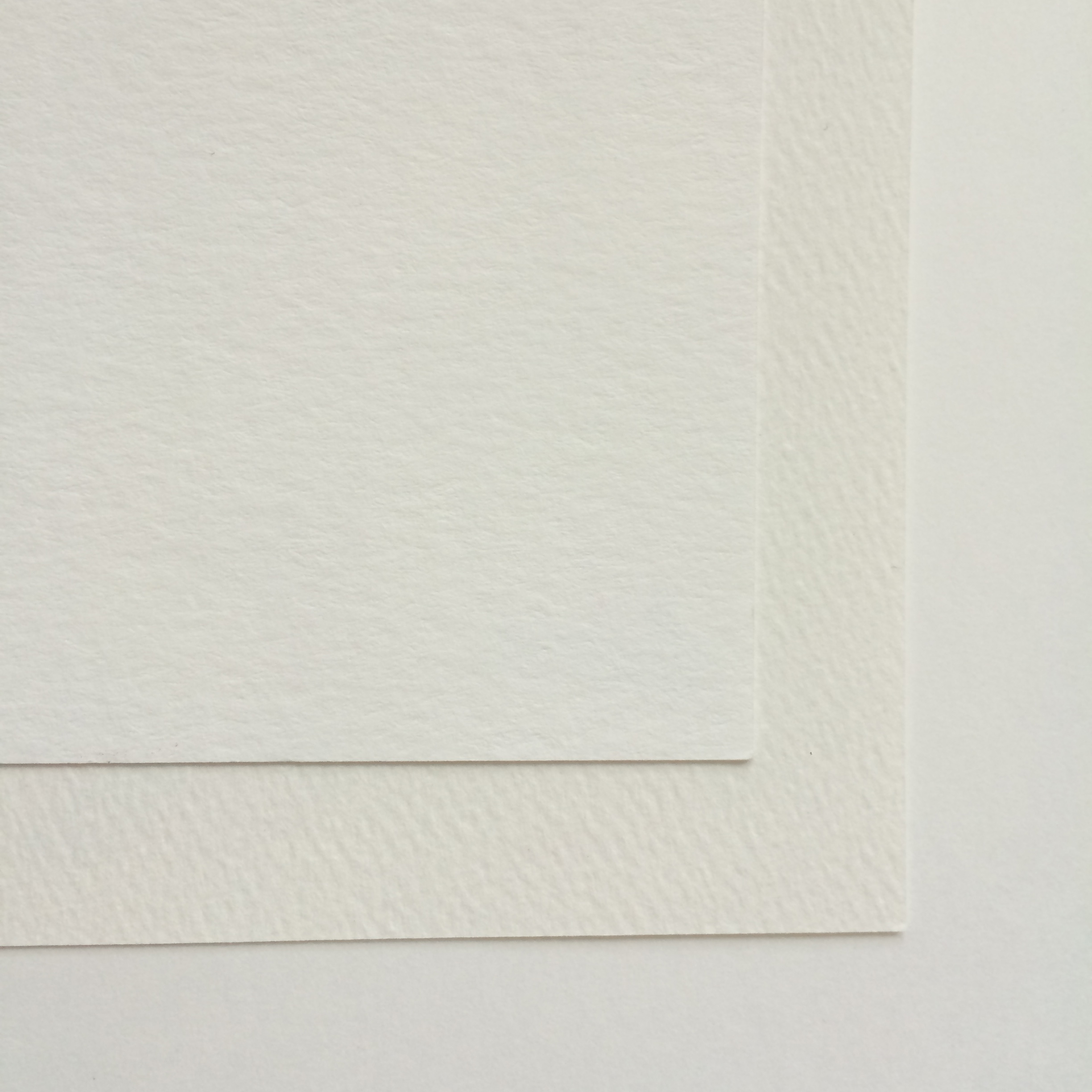 FROM LEFT TO RIGHT: COTTON (TOP), FELT (MIDDLE) AND UNCOATED (BOTTOM) CARD STOCK