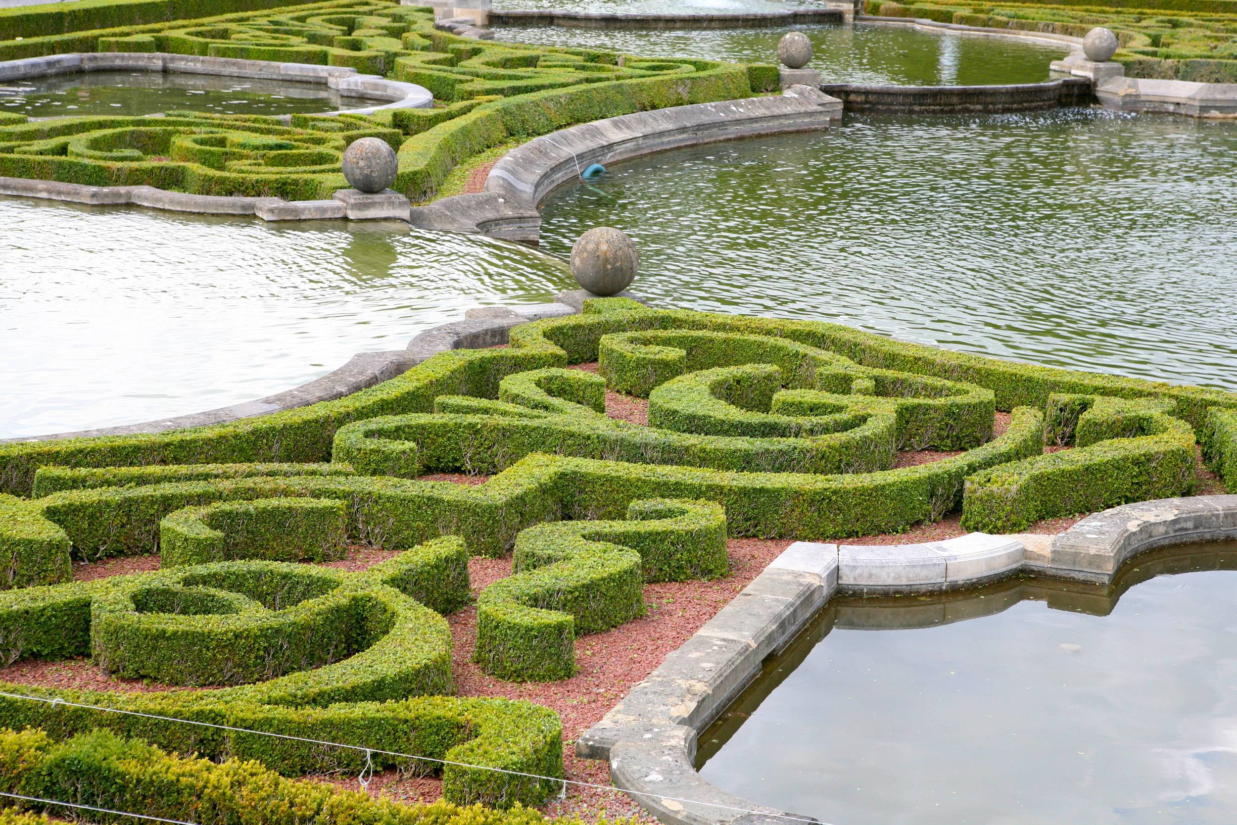 The highly ornate clipped box pattern is a classic element of the European formal garden. This one was installed in the 1920's at  Blenheim Palace , Woodstock, UK.
