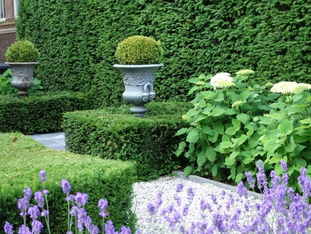 This private garden in Rotterdam, the Netherlands engages the senses with texture, material, shape, scent, and color.
