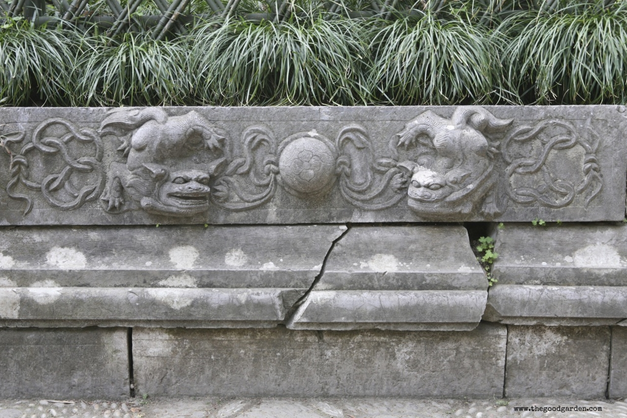 Detail of carved stone planter that defines this space.