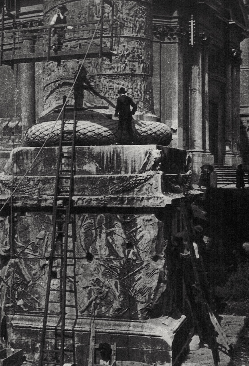 Shutze and colleagues making a rubbing of inscriptions at the base of Trajan's Column, Rome.  Source: E.M. Dowling,   American Classicist.   Smithsonian Institution.