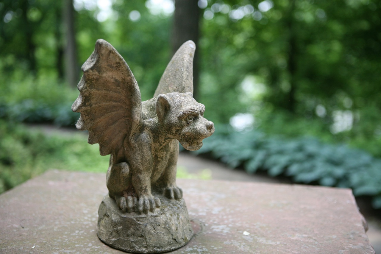 A gargoyle keeps watch over the back garden   and adds a surprise, personal element.