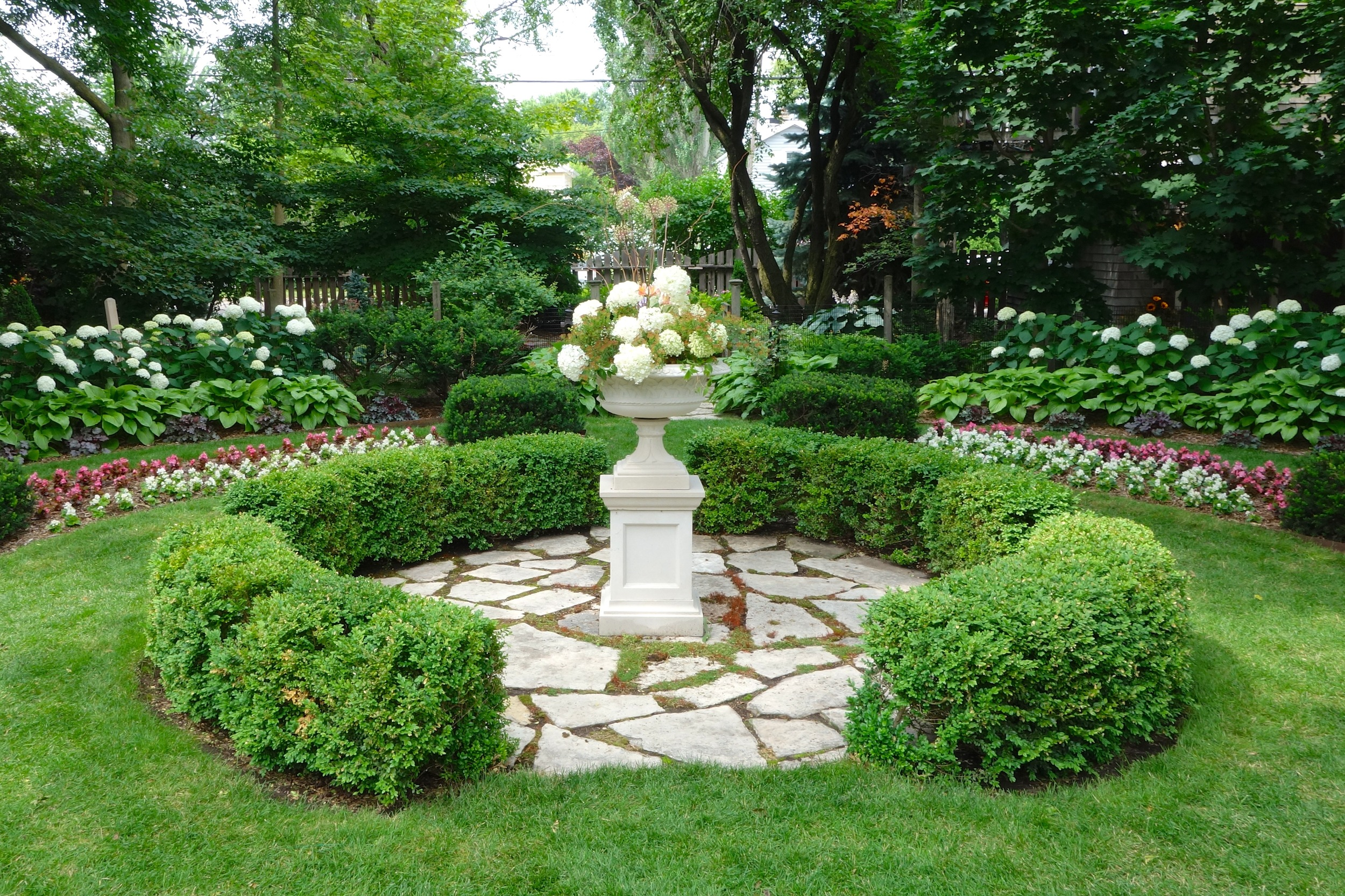 This classic stone urn and pedestal sit on what was originally the sunken rose garden. A perfect focal point.