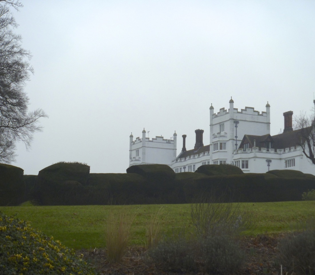 Danesfield House today. The topiary garden lies on the other side of the yew hedge.