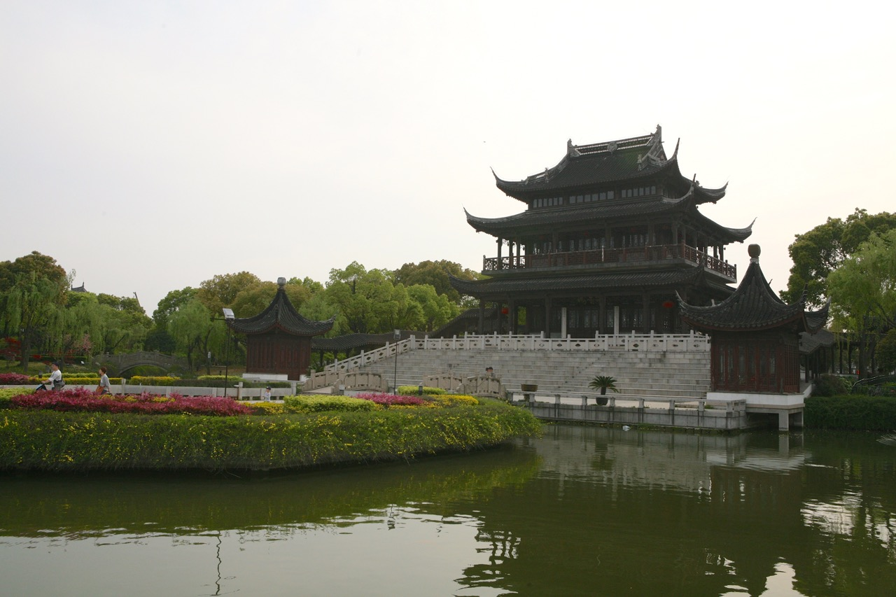 Suzhou, China is an ancient city that dates back to 500 BCE.  Pan Gate was built to protect the city by controlling both land and water access.  Its current structure dates from the 1300's.  It is now preserved as a scenic area planted with cherry trees and peonies.