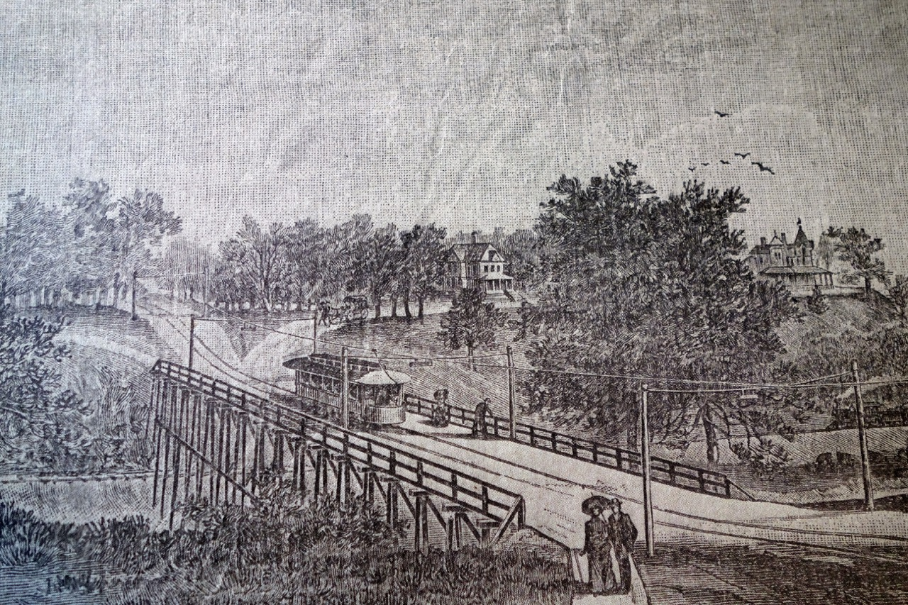 Before: An 1890's lithograph shows the house in the distance set amidst stands of trees and open lawn. The original Fox River bridge was set away from the house. Source: Hearthstone Museum