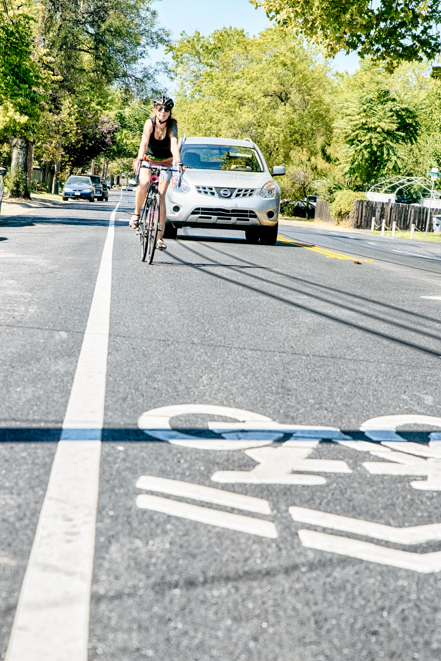 ©Carson Blume   An inexperienced or cautious cyclist may ride on the edge lane, a potentially dangerous place to ride.