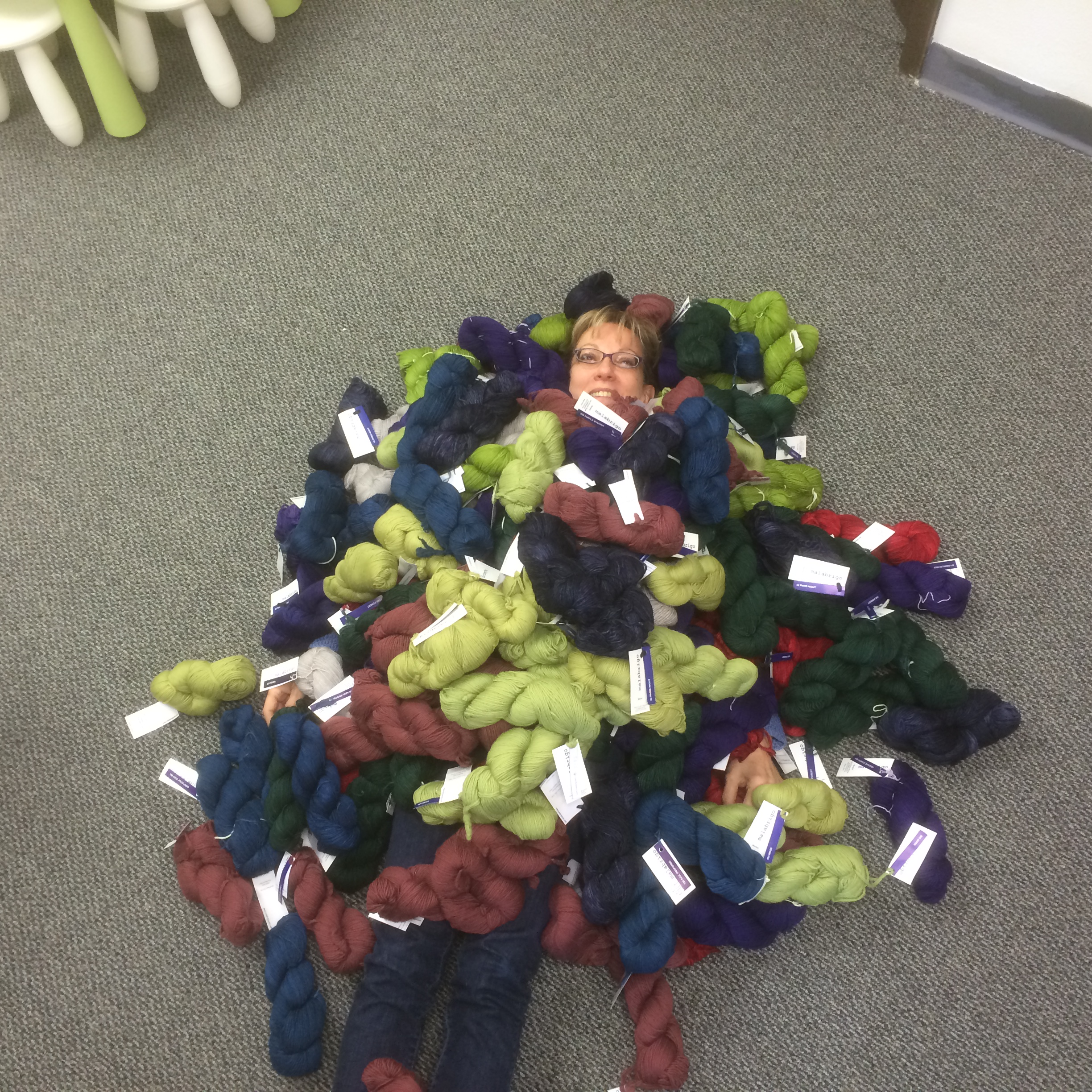 Shelia is buried in our new shippment of Malabrigo Yarn. Come by and feel and touch!!