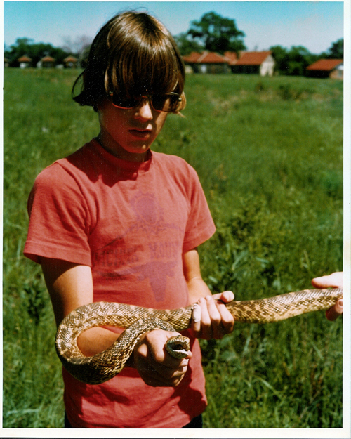 Brent, age 14, with a bullsnake in Chase County, Kansas