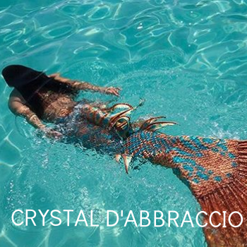 Crystal D'Abbraccio is an avid swimmer, ocean lover, marine advocate and conservationist. These passions contributed to the decision to move with her family to St. John, U.S.V.1. in 2012. When she is not a Mermaid, she can be found enjoying her favorite beaches or island hopping with her husband and two children. Crystal's highly accomplished career in dance education and massage therapy combined with an intrinsic love for the ocean and photography is how Mermaid Swim VI was born.