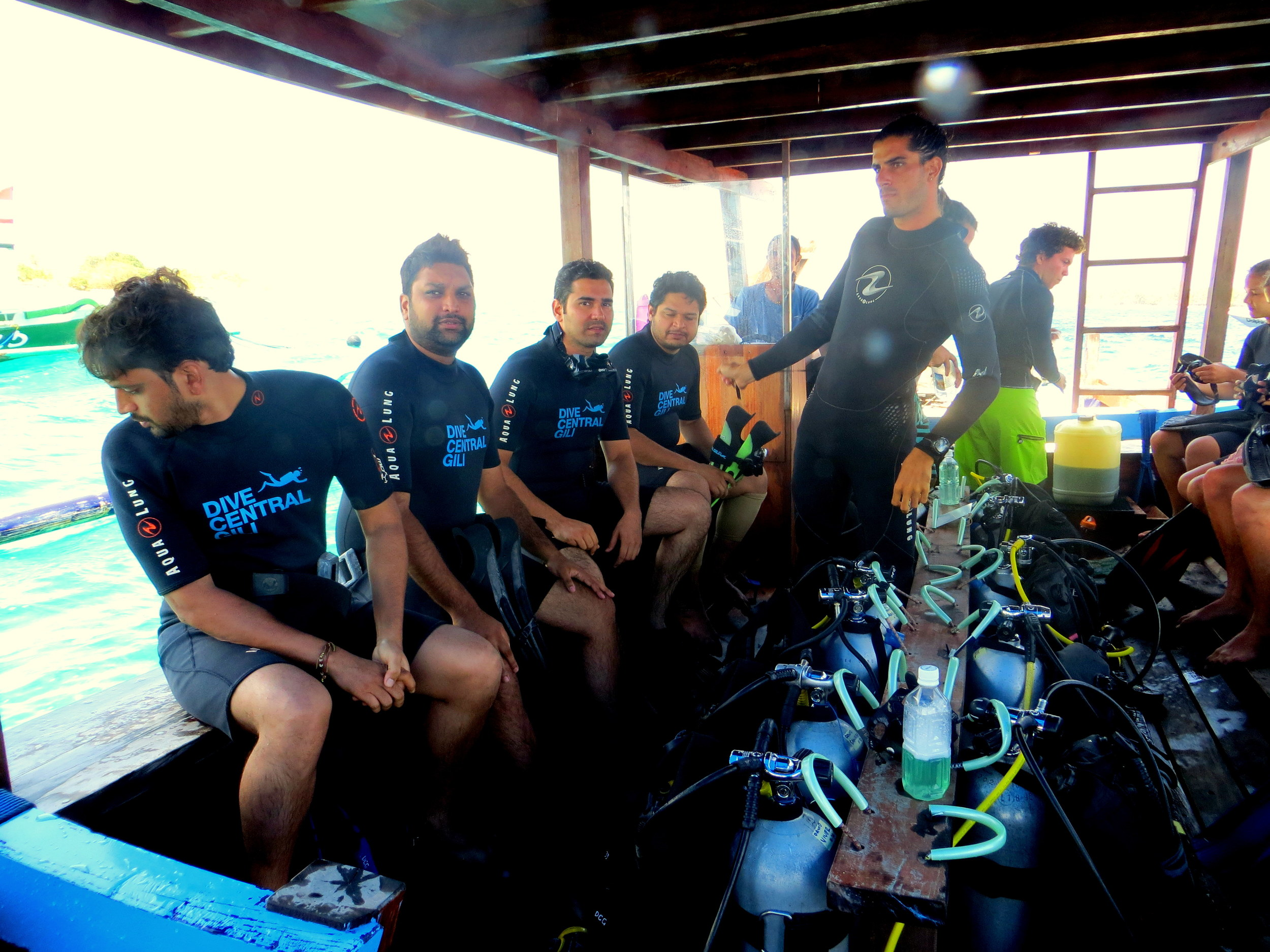Four happy divers, ready to take the pluge. we always keep water on the boat, so it is easy to stay hydrated!