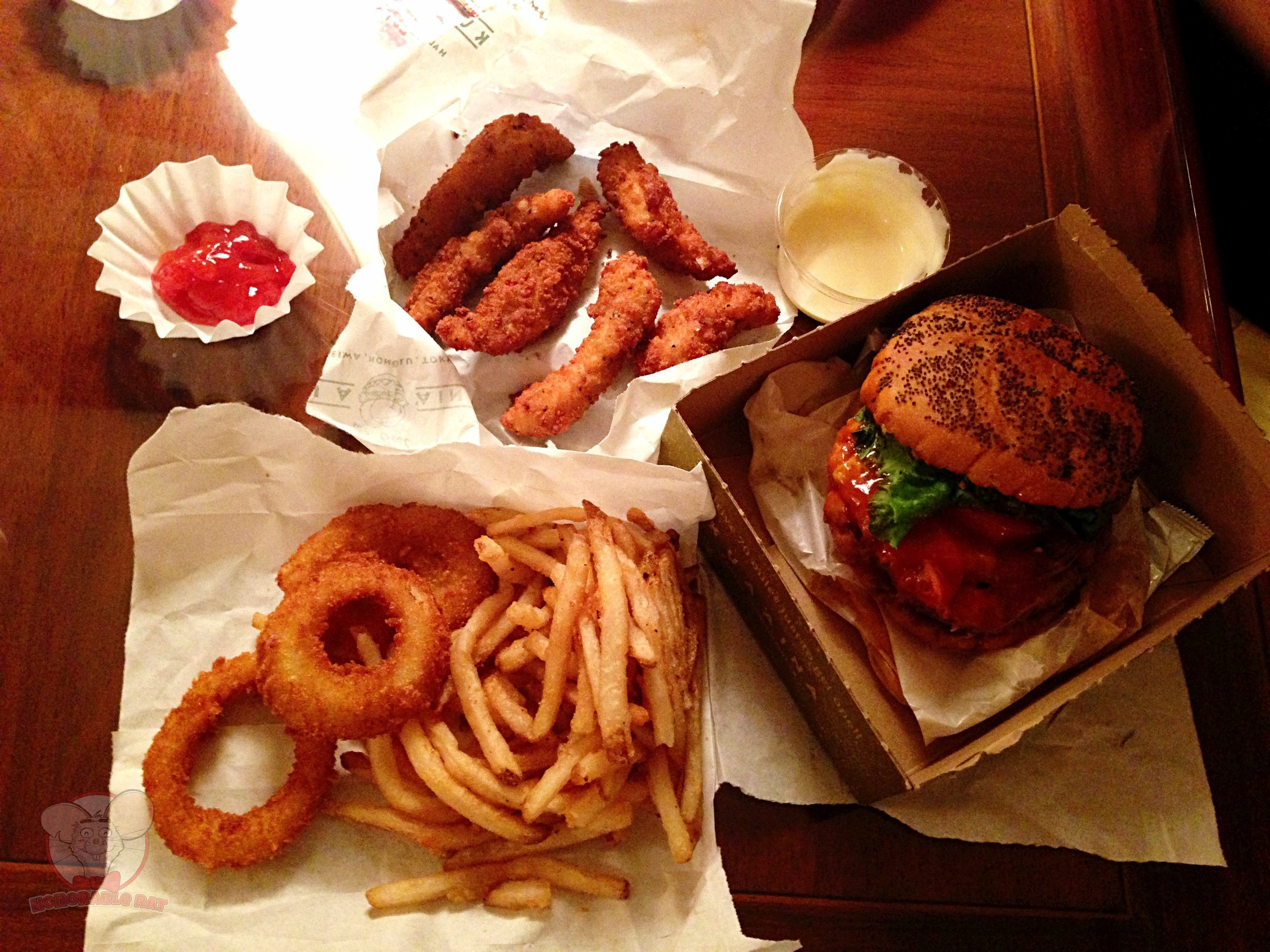 My dinner from Kua'Aina. A seasonal 1/4 pound Kilauea Spicy burger set and of course, The Crispy Finger Chicken