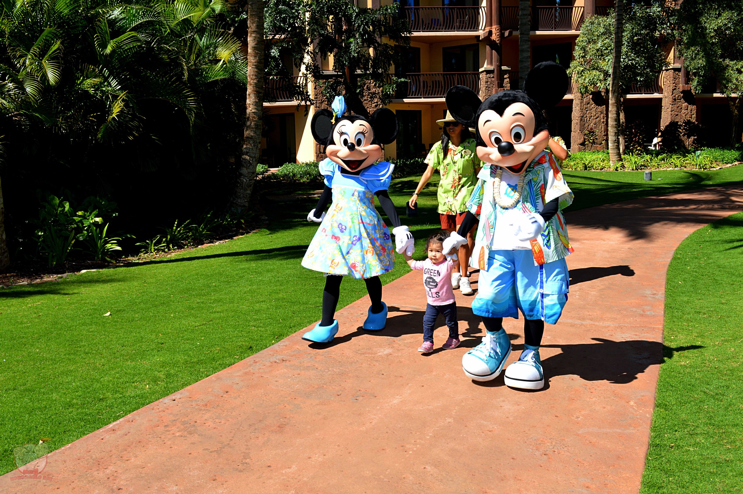Walking hand in hand with Mickey and Minnie