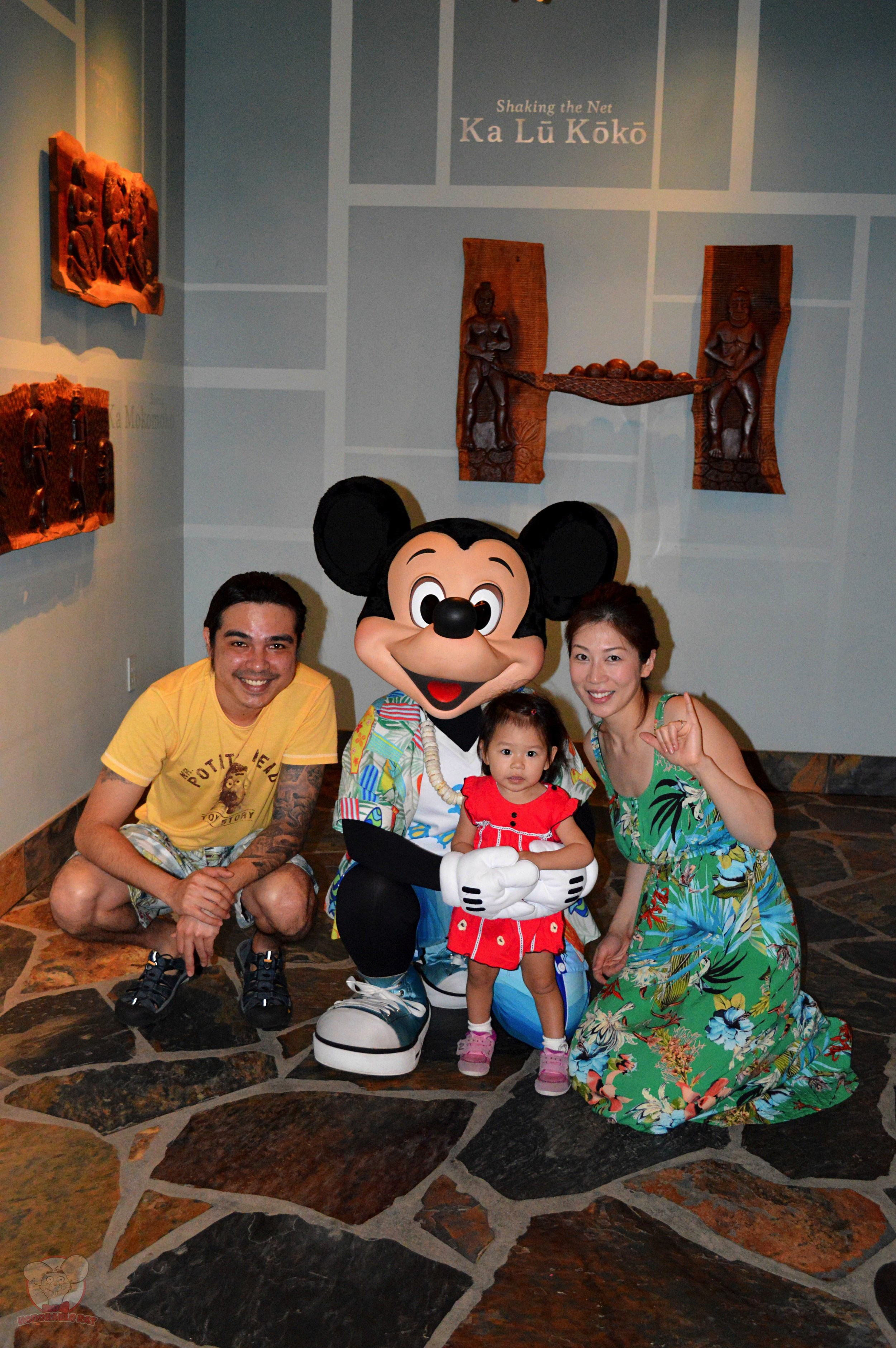Before heading to our table, we took a family picture with Mickey