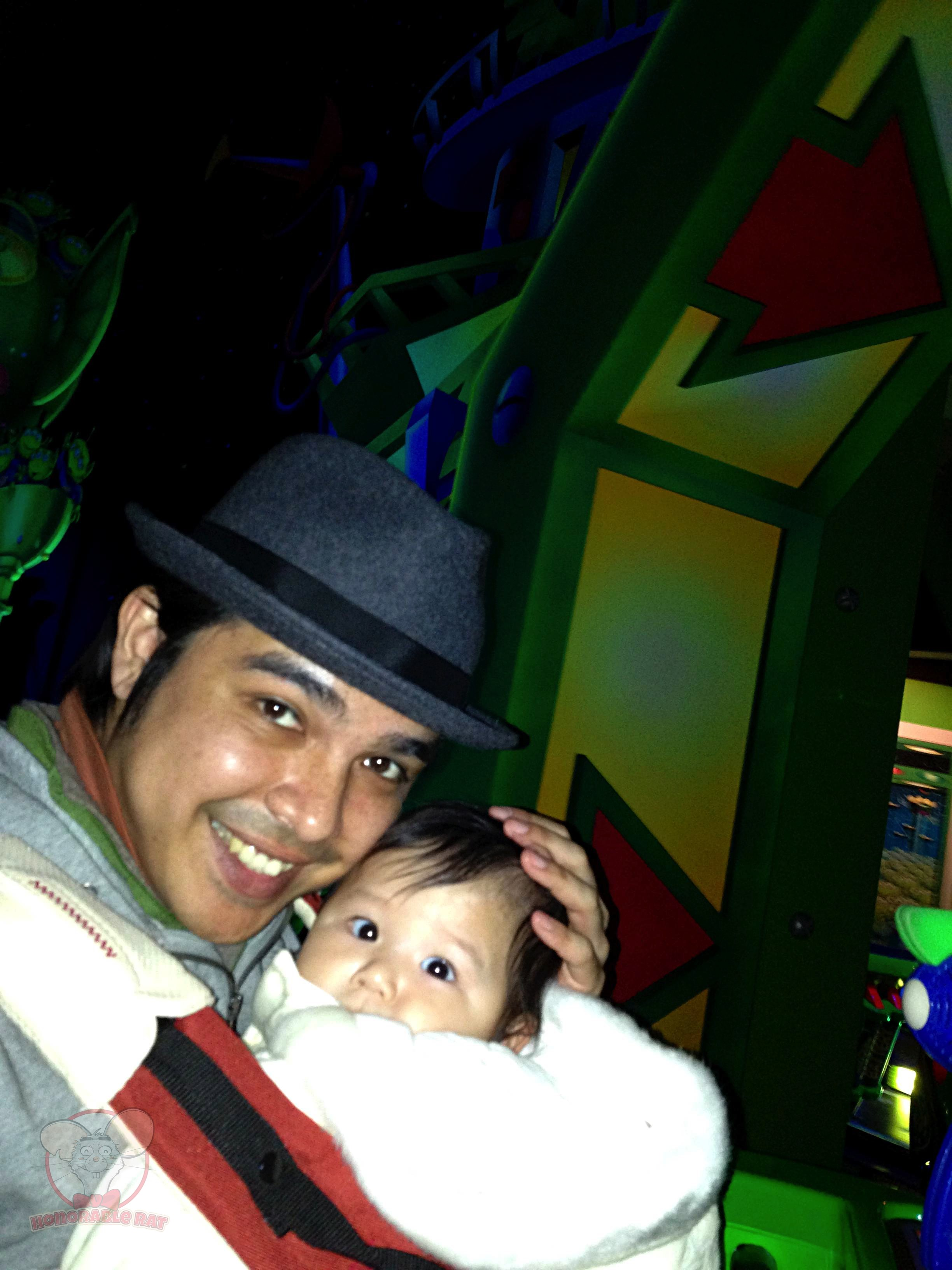 IN the ride vehicle with Mahina IN her baby carrier IN Buzz Lightyear's Astro Blasters IN Tomorrowland IN Tokyo Disneyland