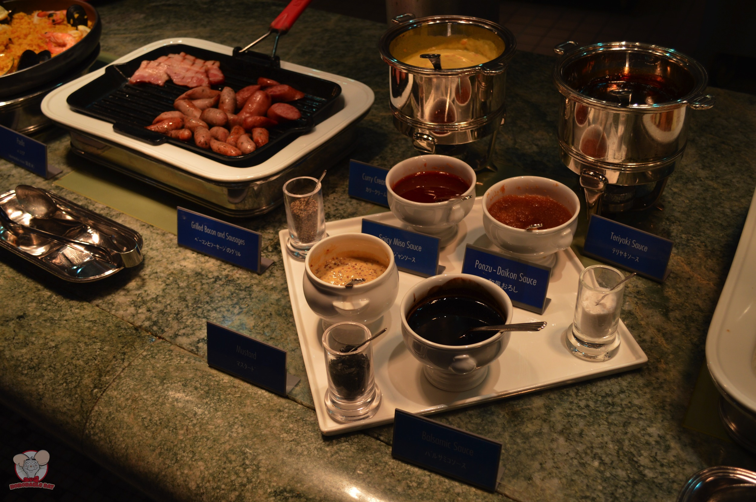 Grilled Bacon and Sausages (Left), Assortment of sauces (Right)