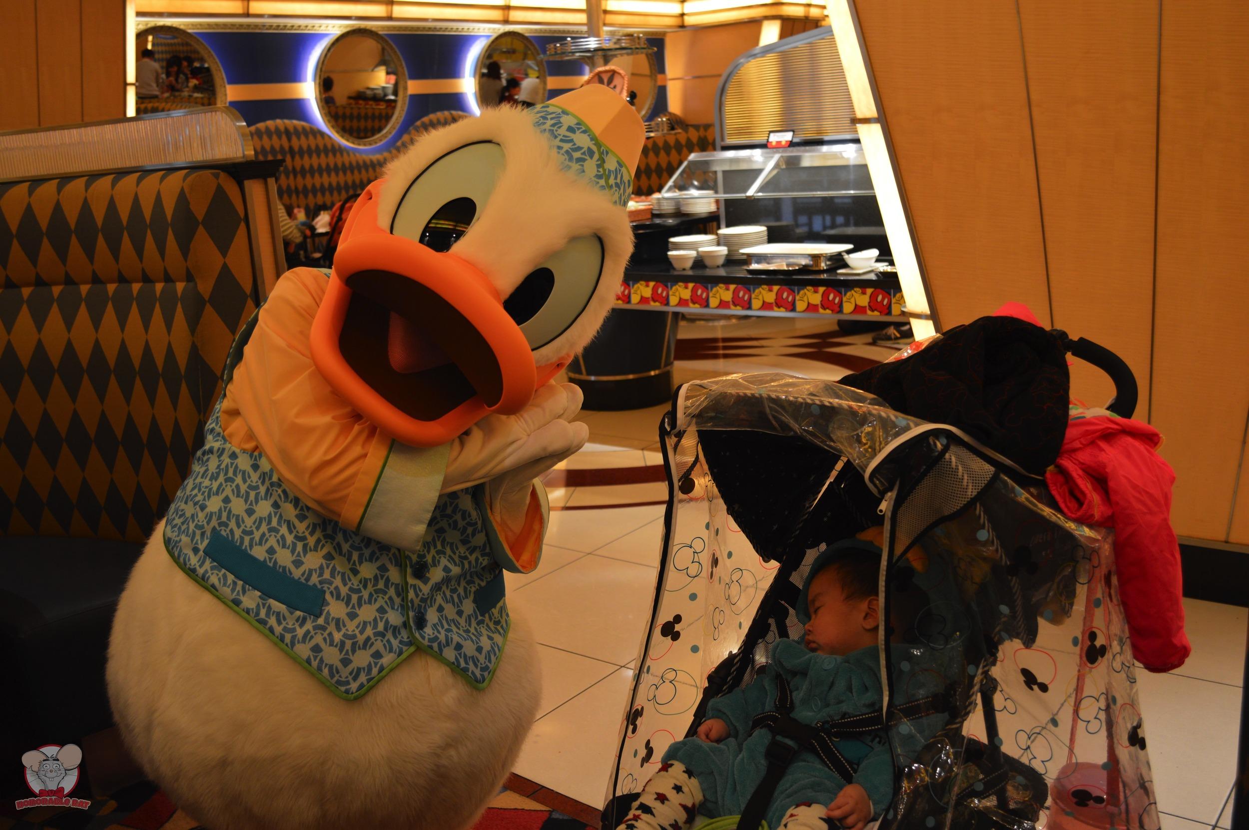 Donald with a sleeping Baby Haku