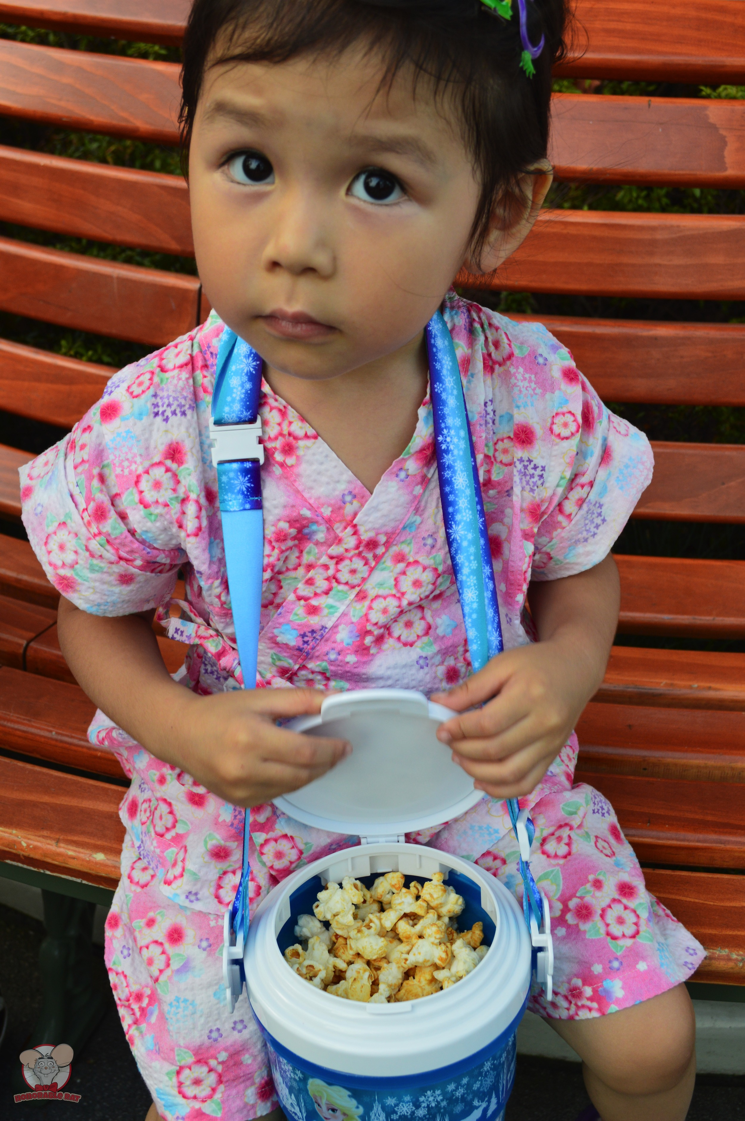 Little Mahina opening the popcorn bucket