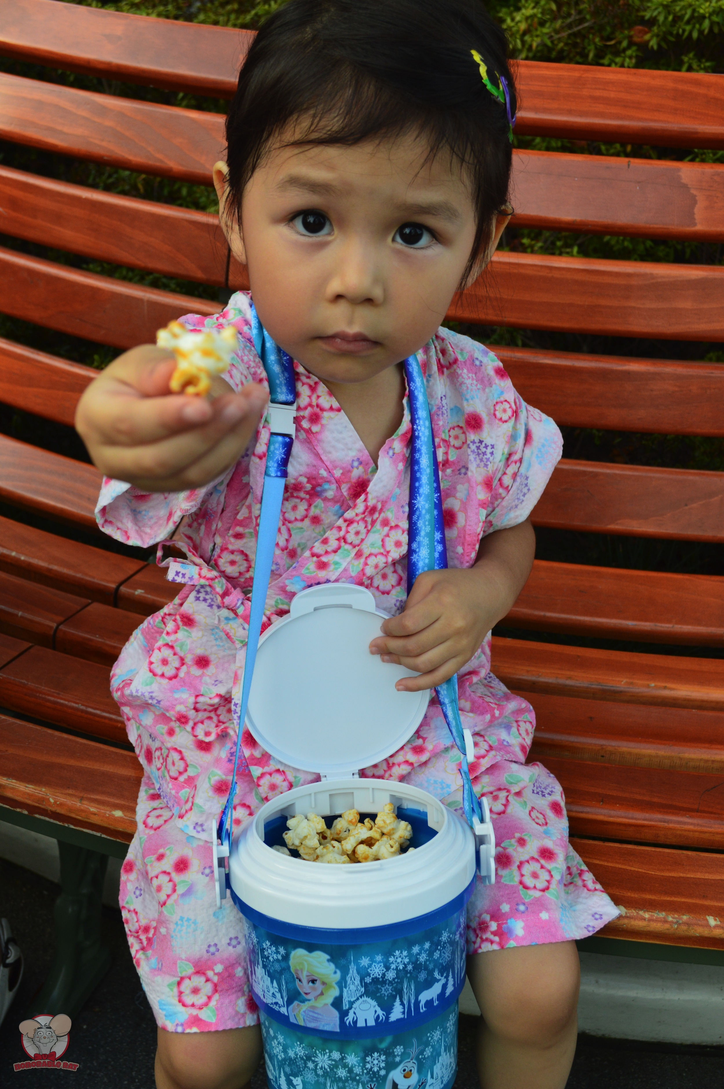 Little Mahina offering you a popcorn