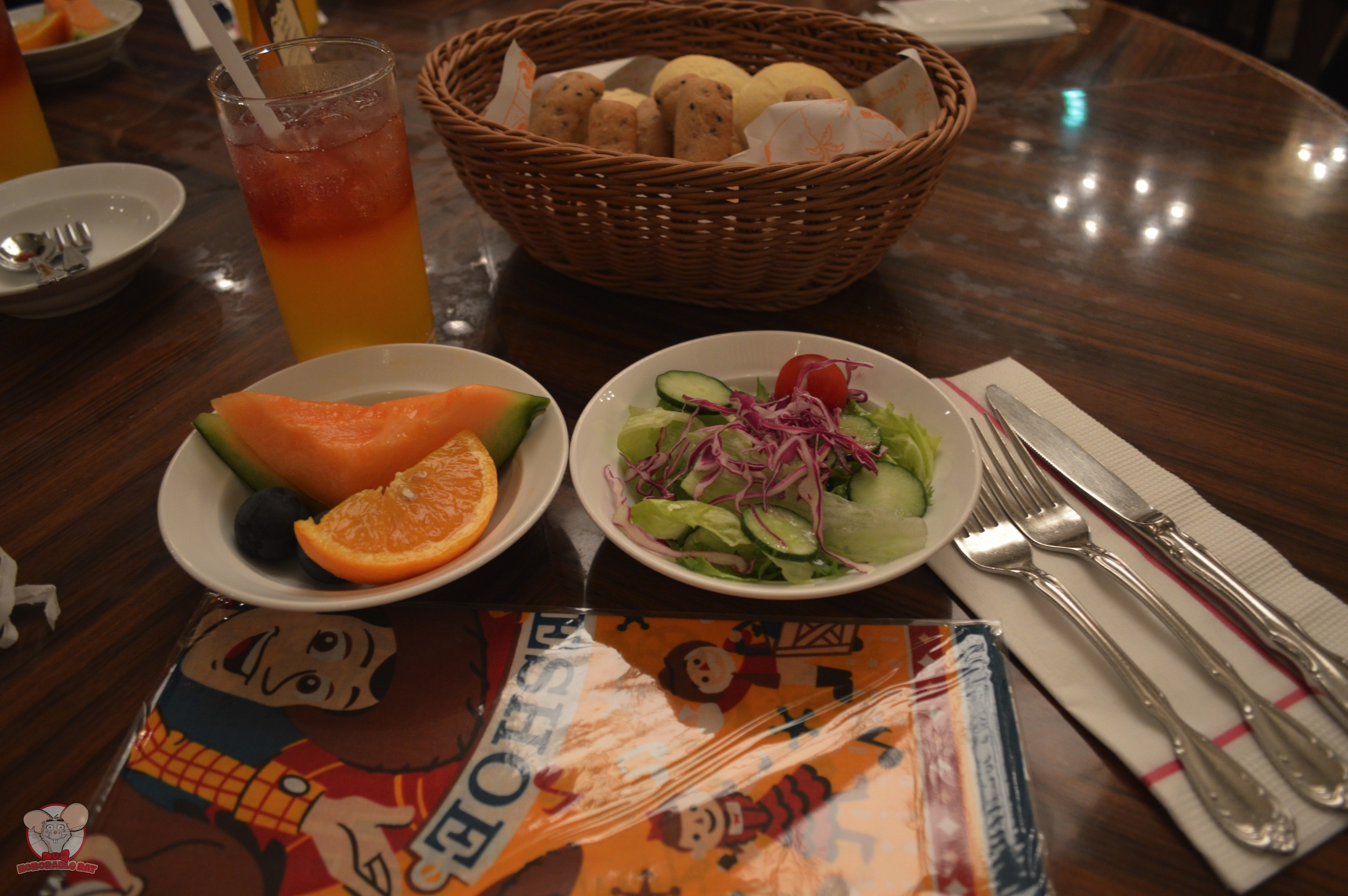 Fruits, salad, bread & drinks to go along with your breakfast