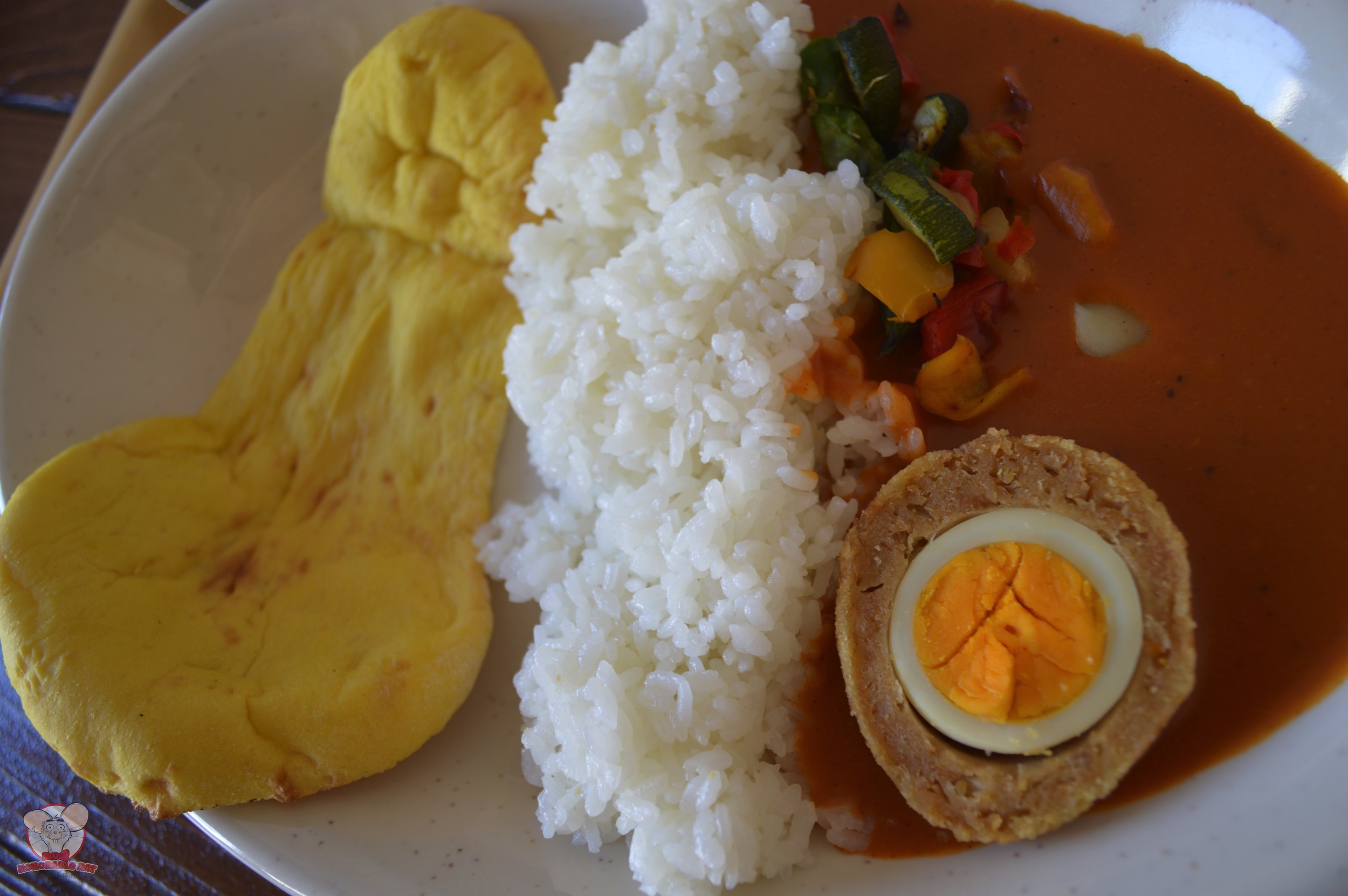 Butter Curry with Chicken-Scotch Egg and Vegetables Served with Rice and Naan