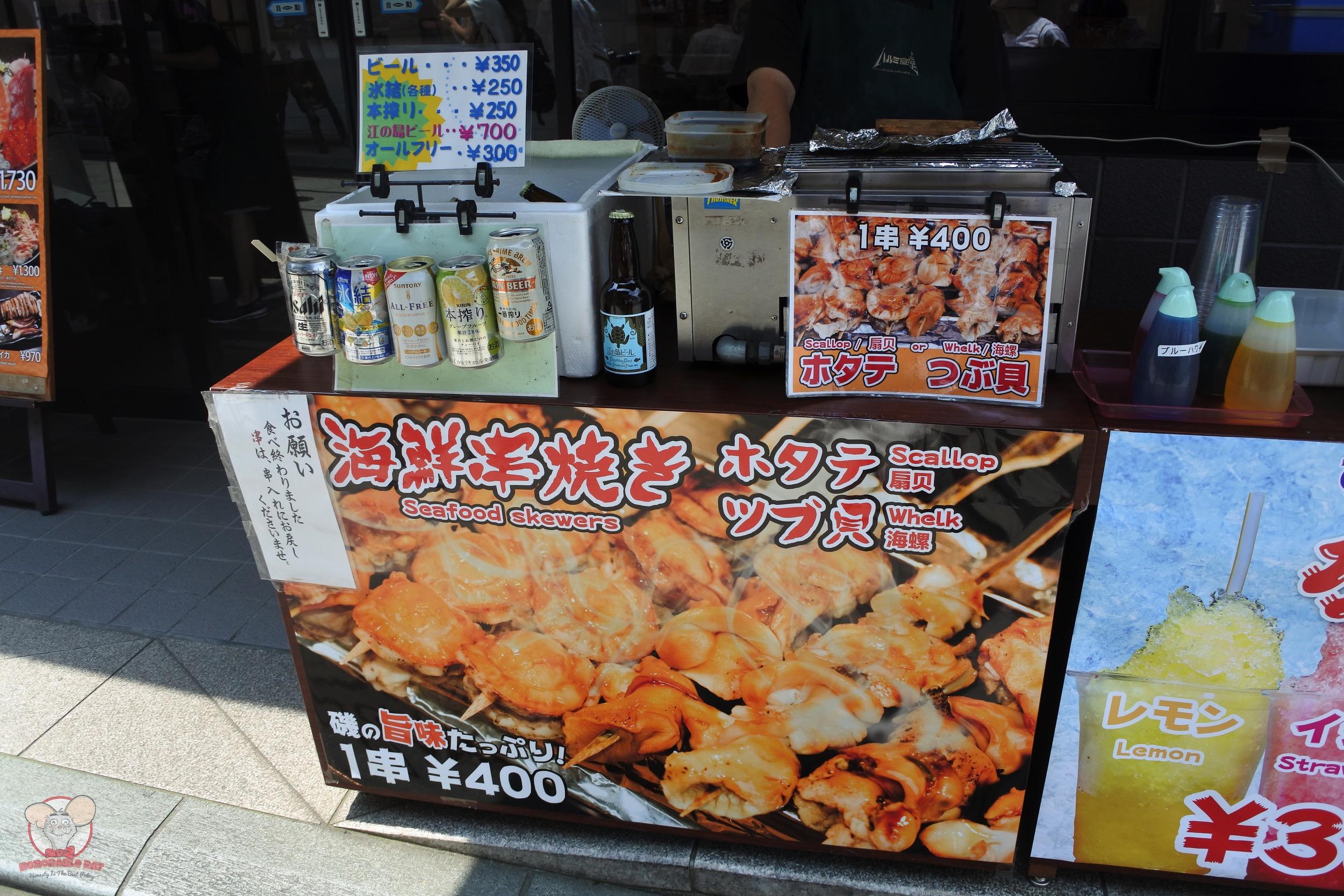 Stall outside Harumi Shokudou selling Seafood Skewers