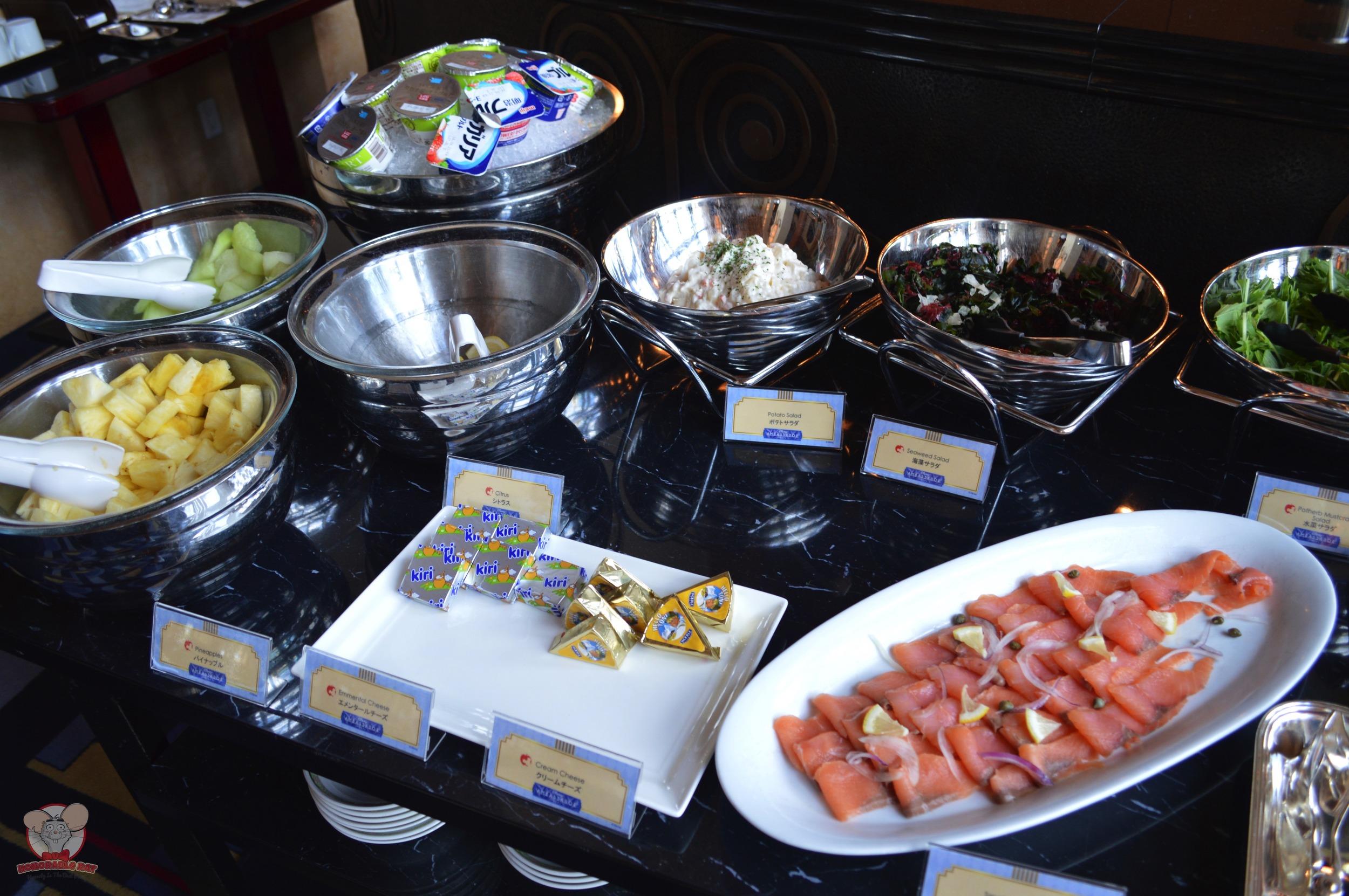 Fruits, yogurt, salad, cheese and salmon