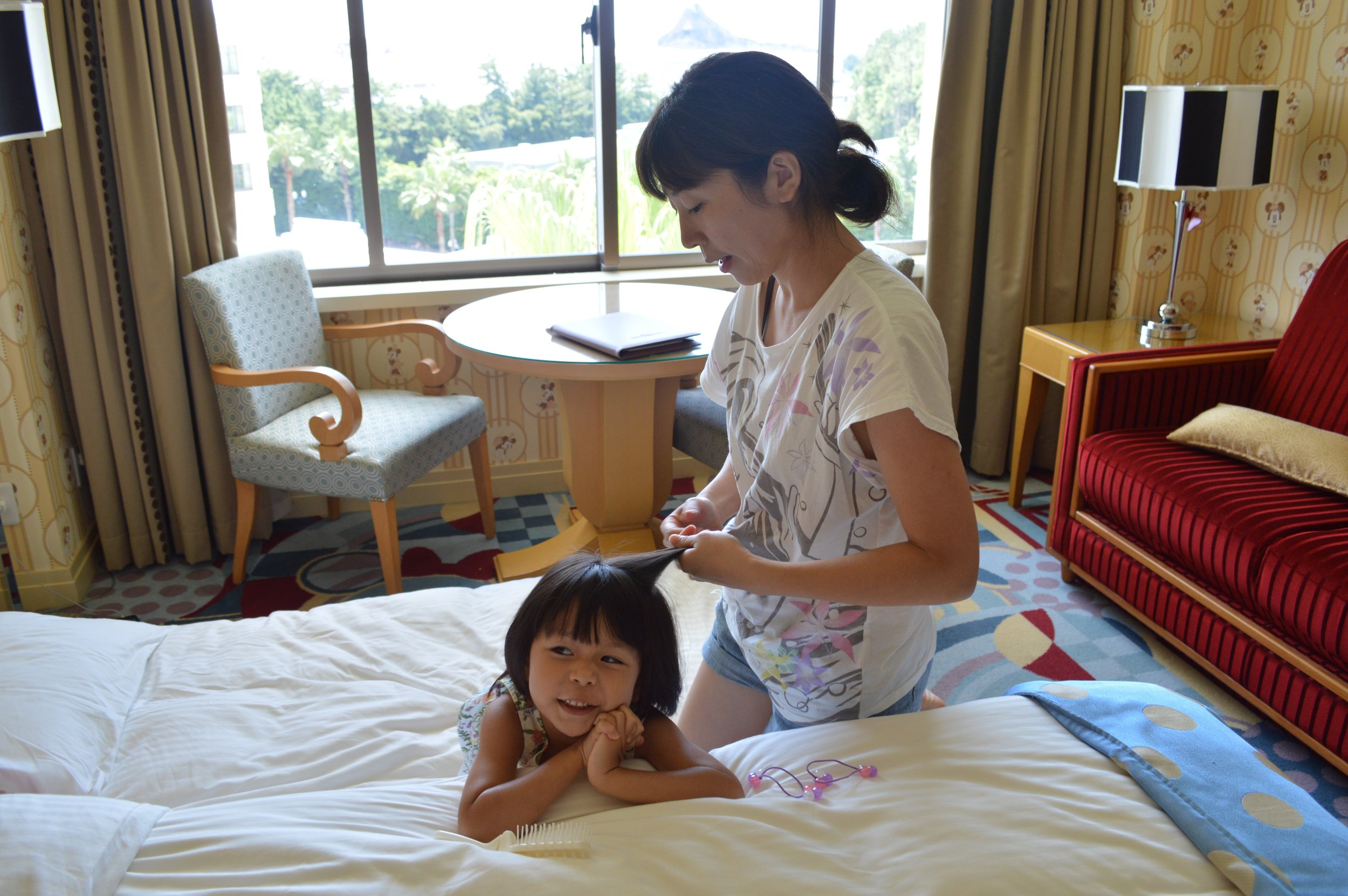 Mummy getting Little Mahina ready for a day in DisneySea