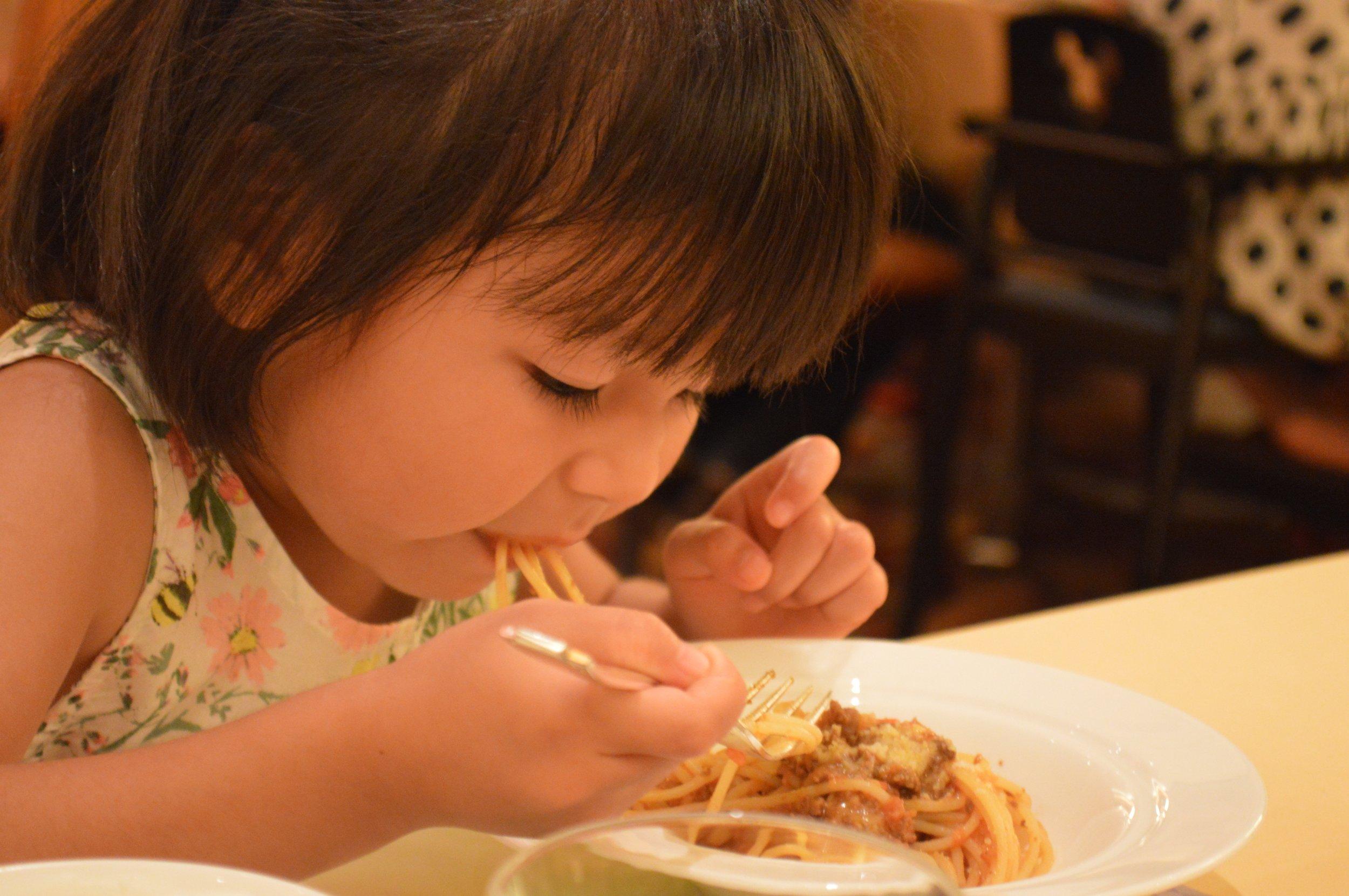 Little Mahina enjoying her spaghetti