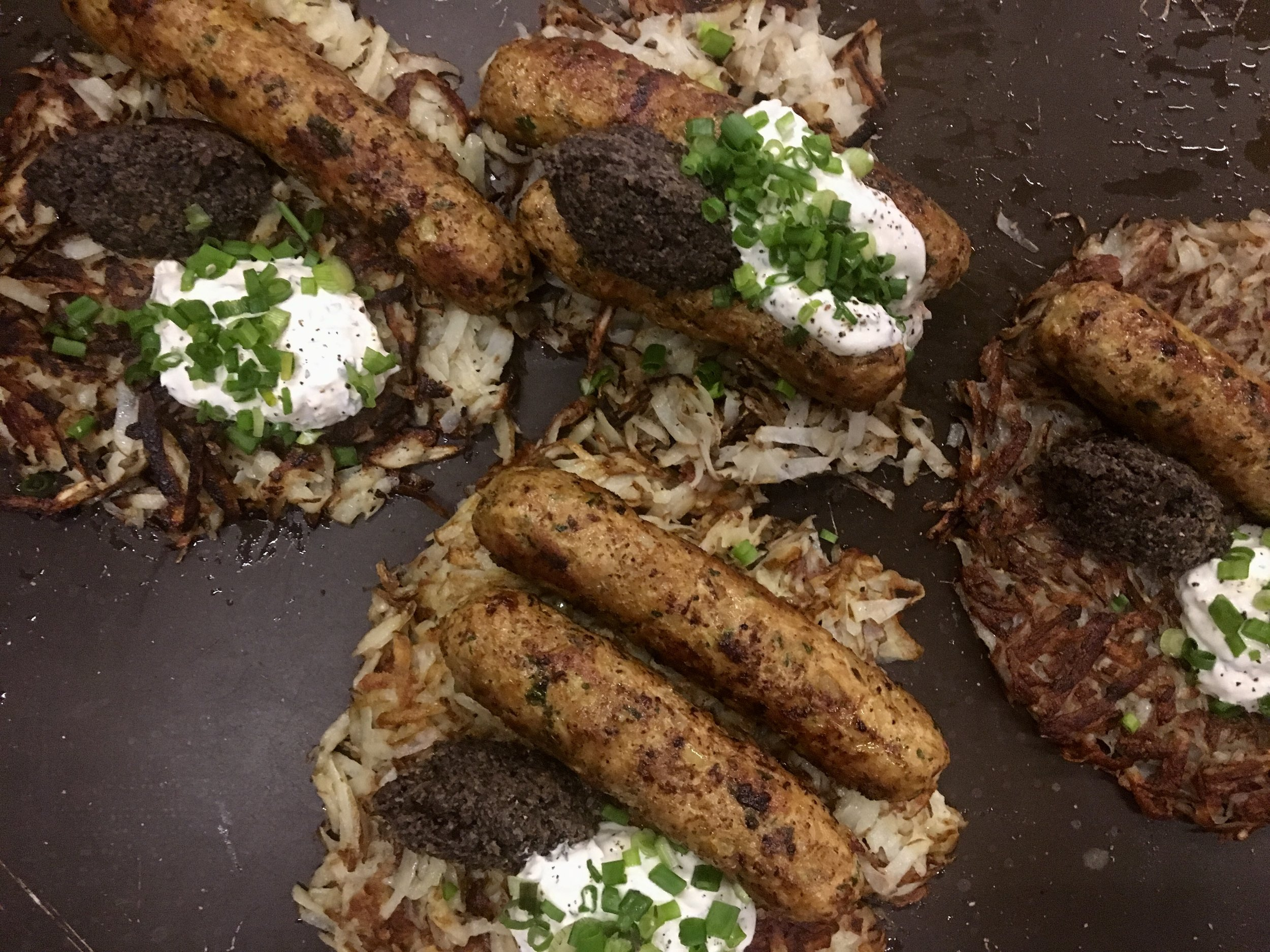 Rosti, mushroom caviar, house made sausage with sour cream