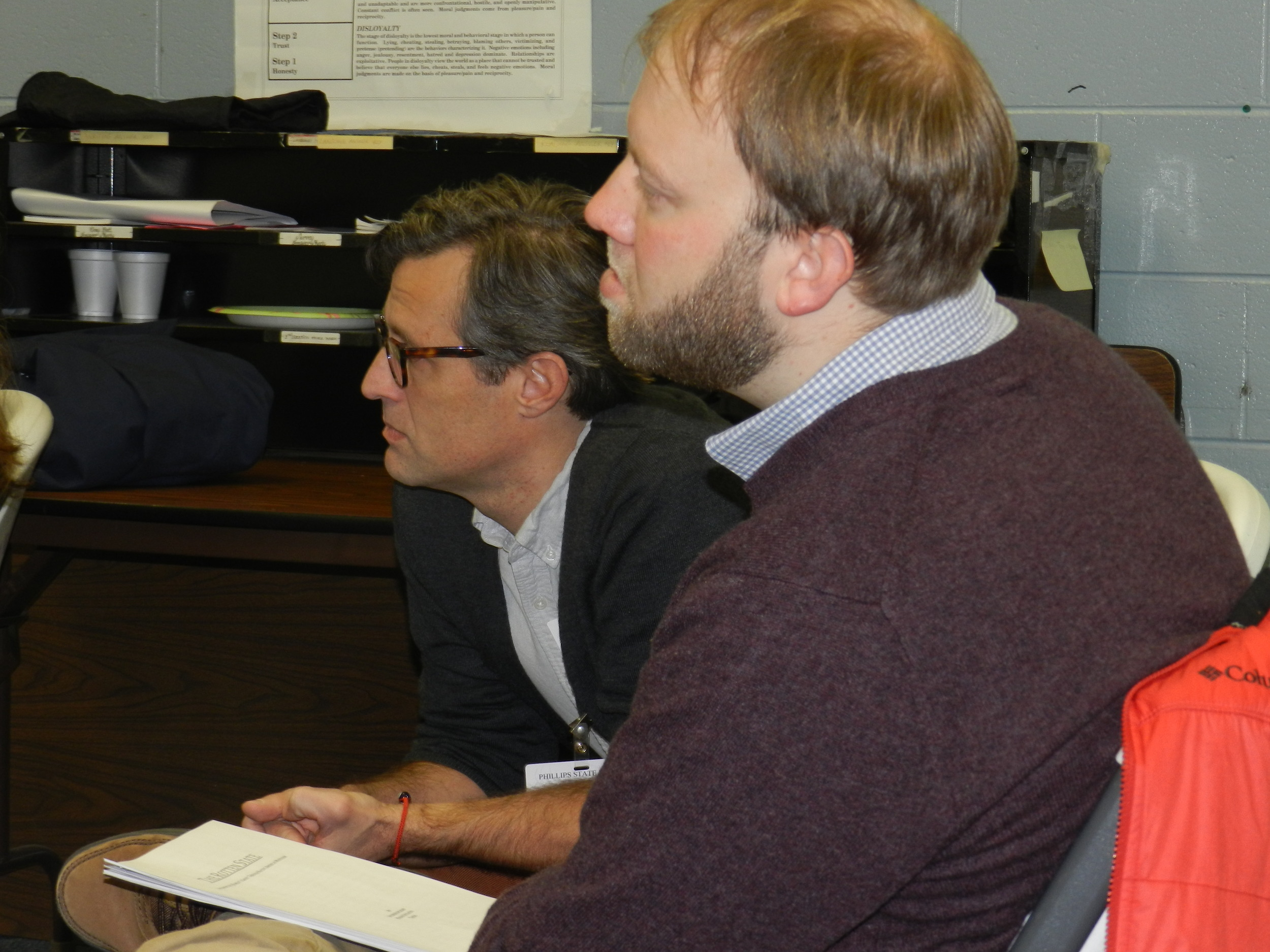 Dr. Stivers and Dr. Rettberg listen to the conference presentations