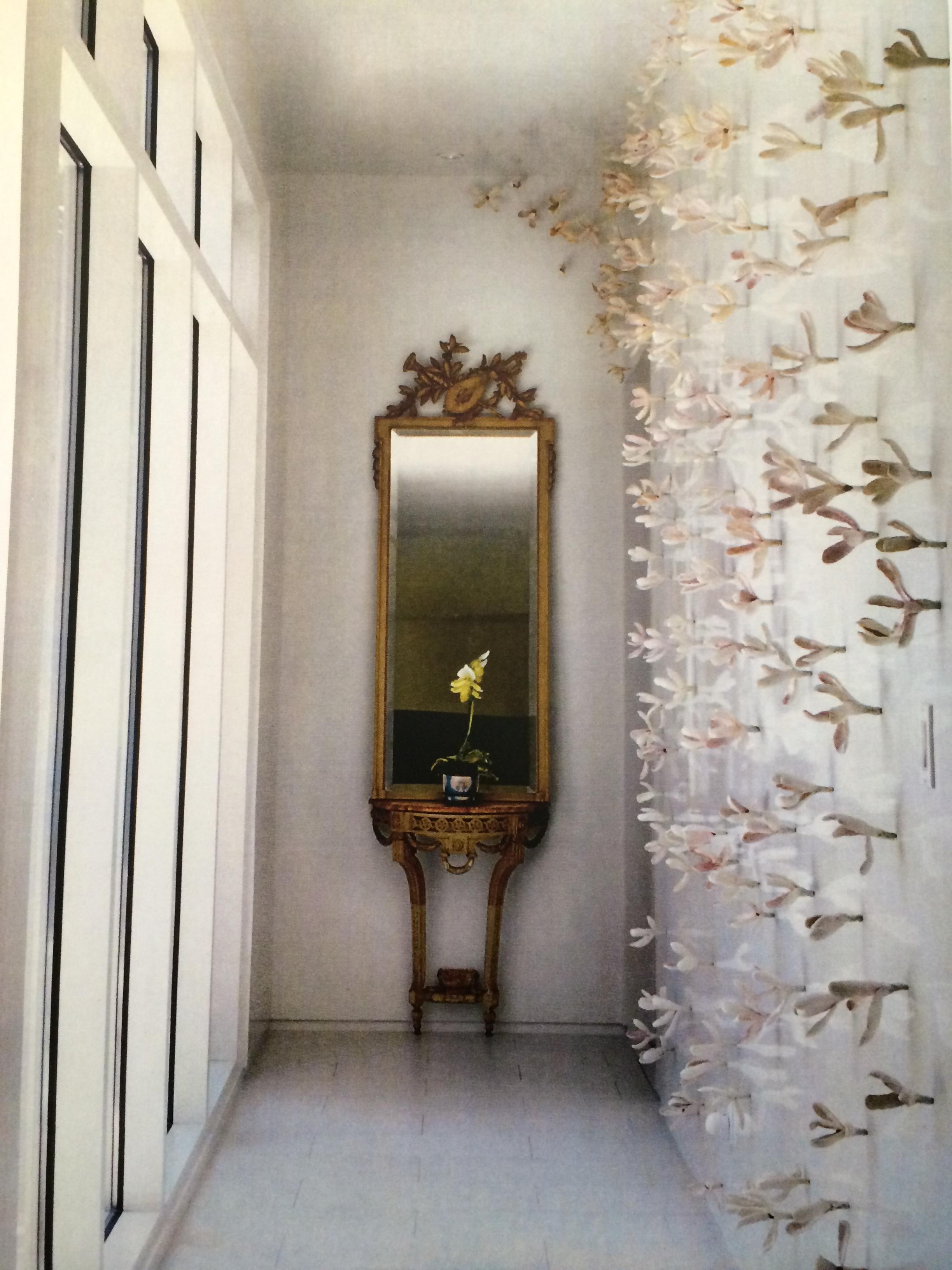 Japanese Magnolia wall installation. Bradley Sabin. 16 pieces glazed ceramic magnolas with steel screws. Value: $600.00.
