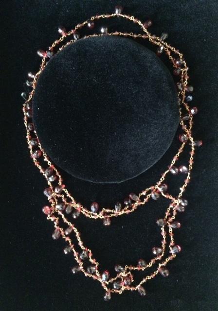 14K gold clad garnet necklace, value: $285