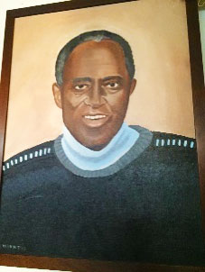"""Henry """"Mac"""" MacDonald watches over the Food Pantry through this beautiful painting by ICSJ parishioner, Lisa Magnin"""