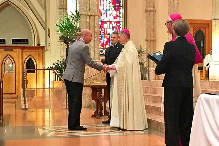 John Siebert receive the Christifidelis Award from Cardinal elect Blasé Cupich