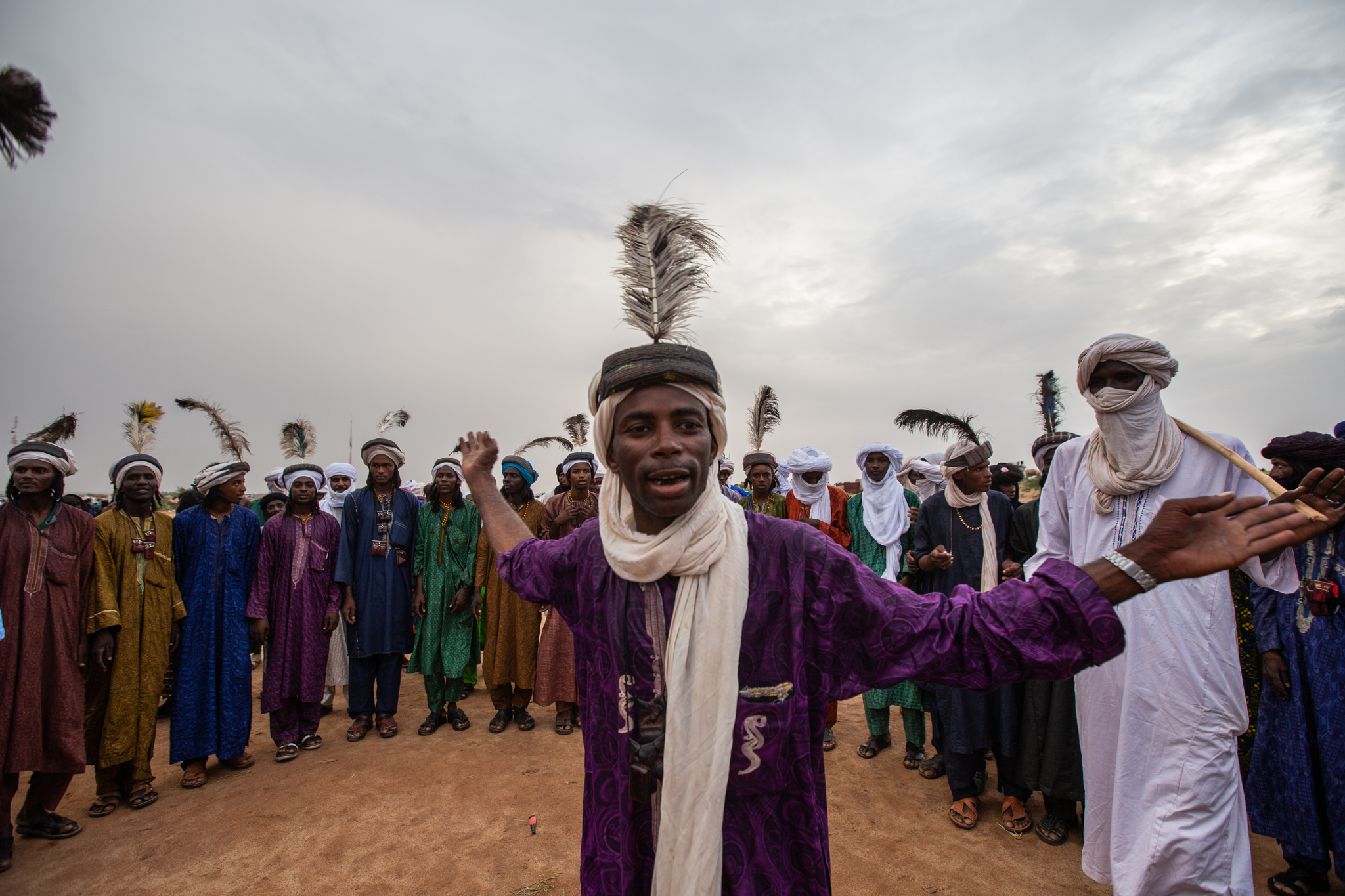 Young Wodaabe men get together to show their skills singing, dancing, and seducing the crowd.