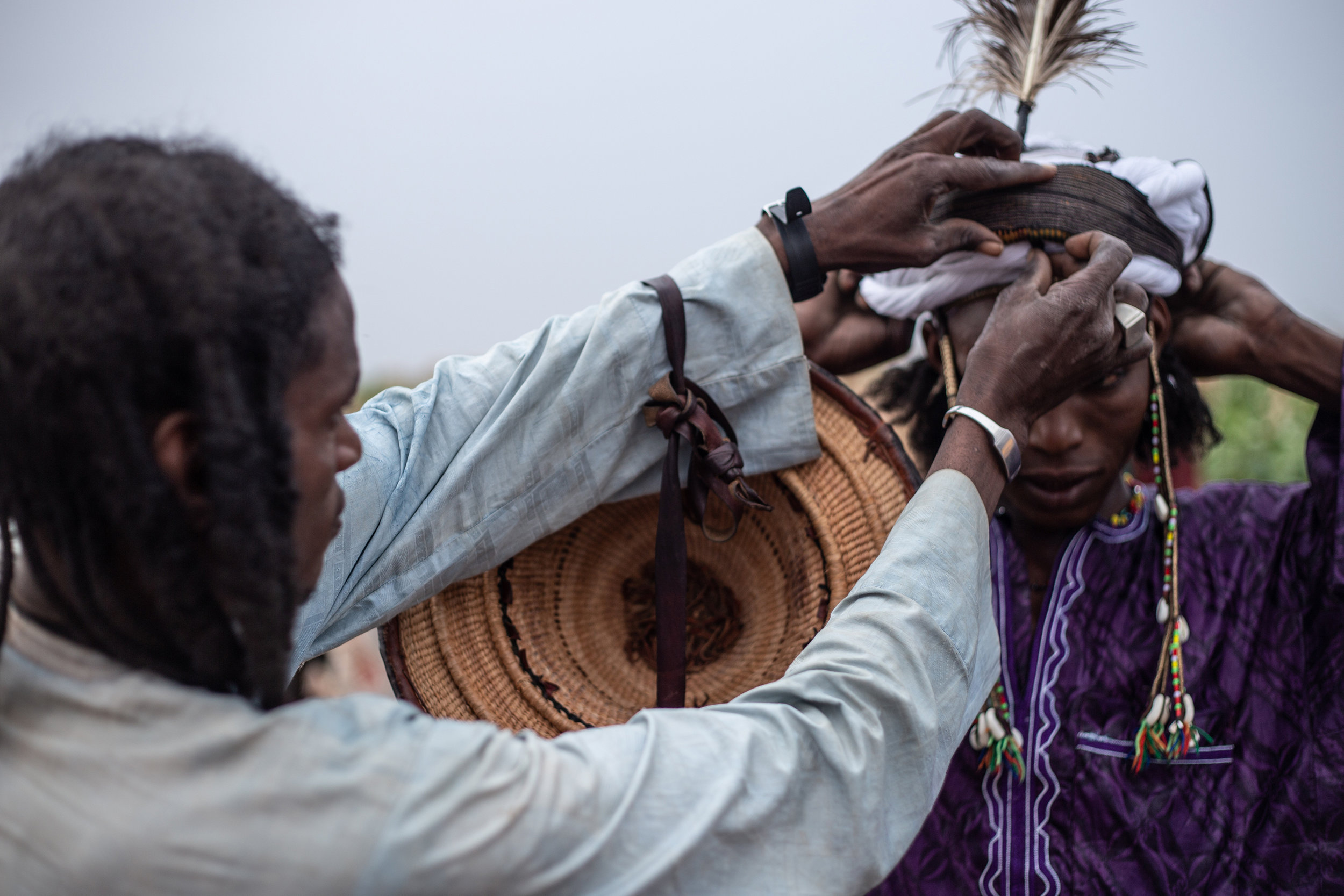 Wodaabe men prepare themselves with meticulous makeup and feathers in hopes of finding female companionship.