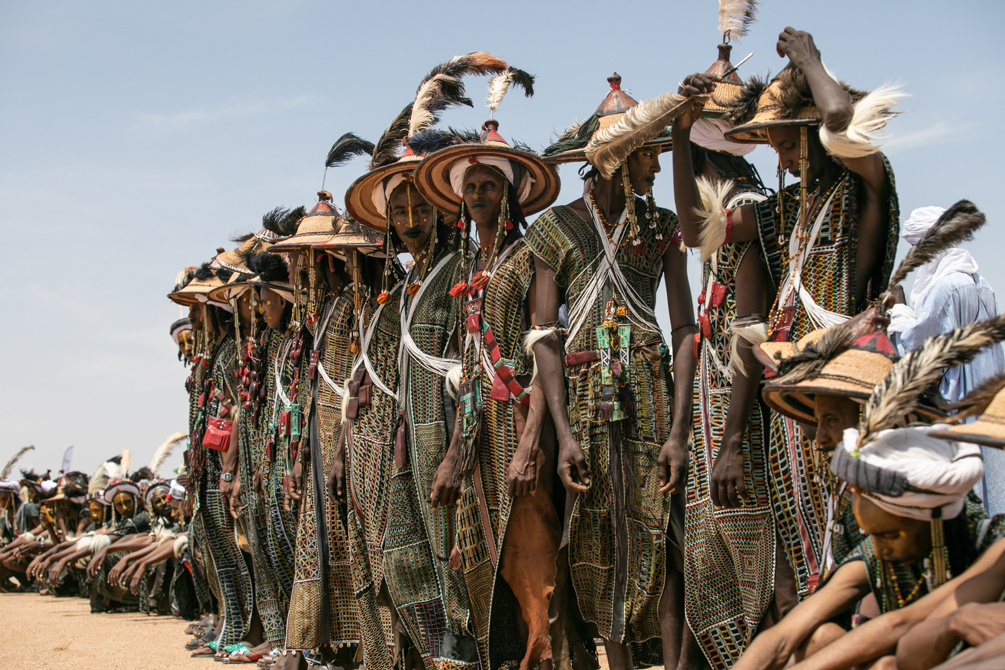 Young Wodaabe prepare themselves with meticulous makeup and feathers in hopes of finding a mate.