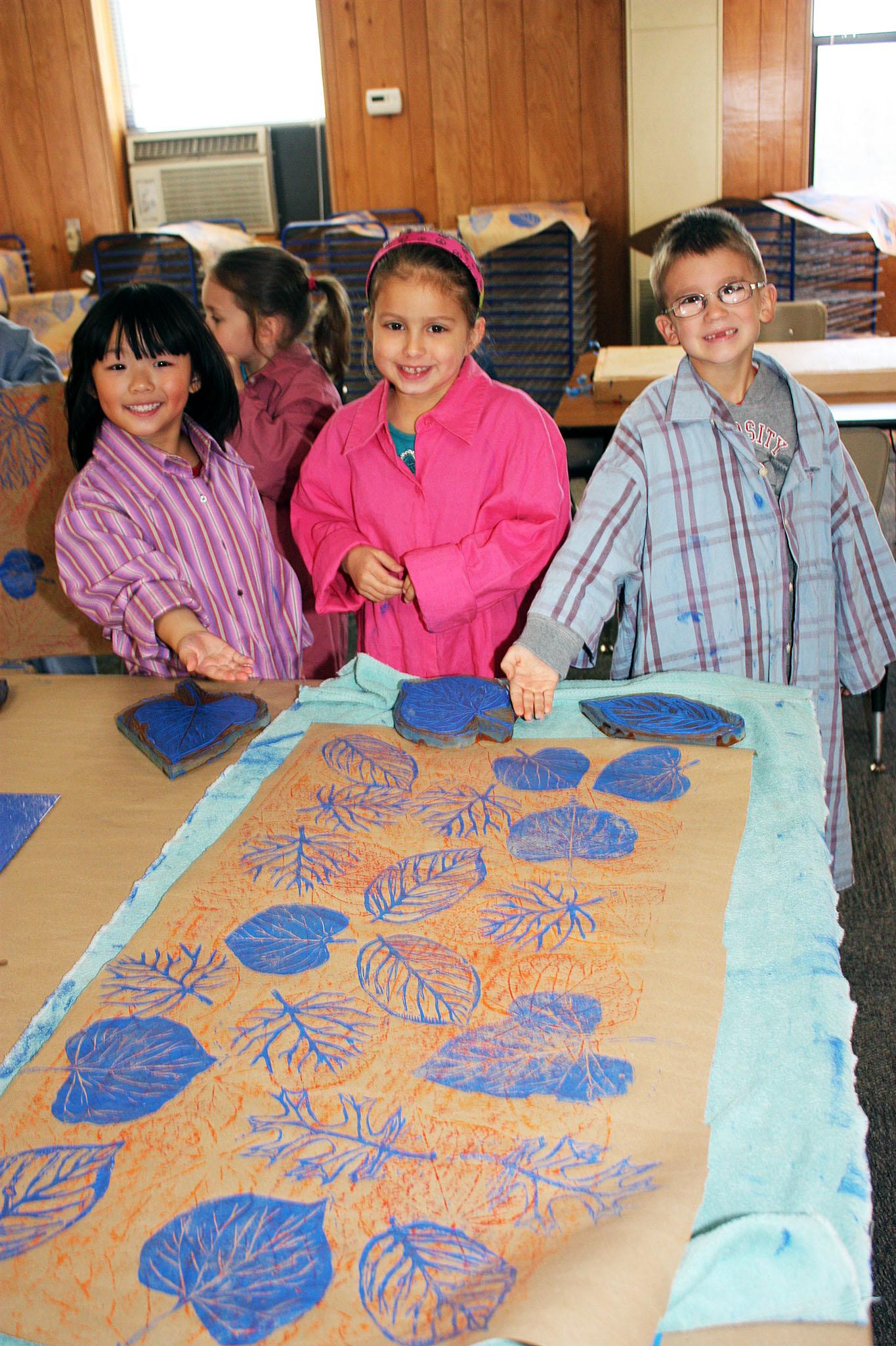Students show off their handiwork at the Children's Summer Art Program.