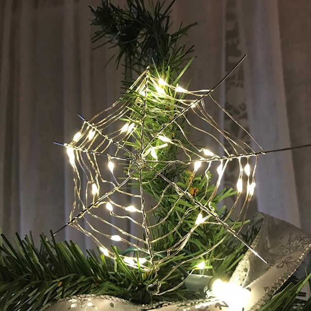 Our old Christmas tree topper had seen better days. So I made this out of paper clips and twinkle lights. #ChristmasDIY #Christmas