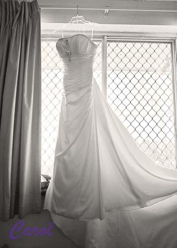 wedding dress backlit in window