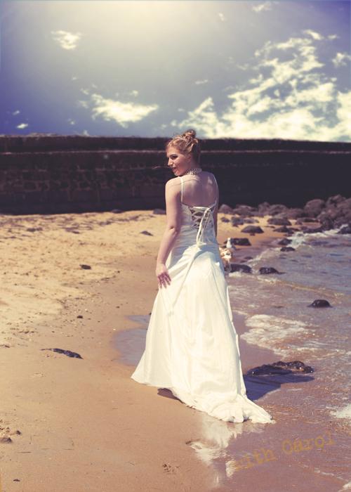bride on beach st kilda trash the dress