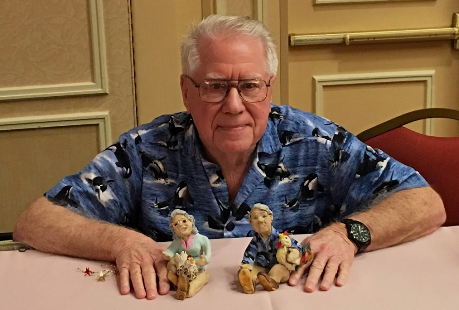 Bob Bailey poses with his signature whale shirt and models of himself and his late wife, Marian Breland Bailey. Why chickens on their laps? Training chickens are just one of 143 species they have trained over the years. The Edward L. Anderson Jr. award was presented to Bob during the 2016 Art and Science of Animal Training Conference.