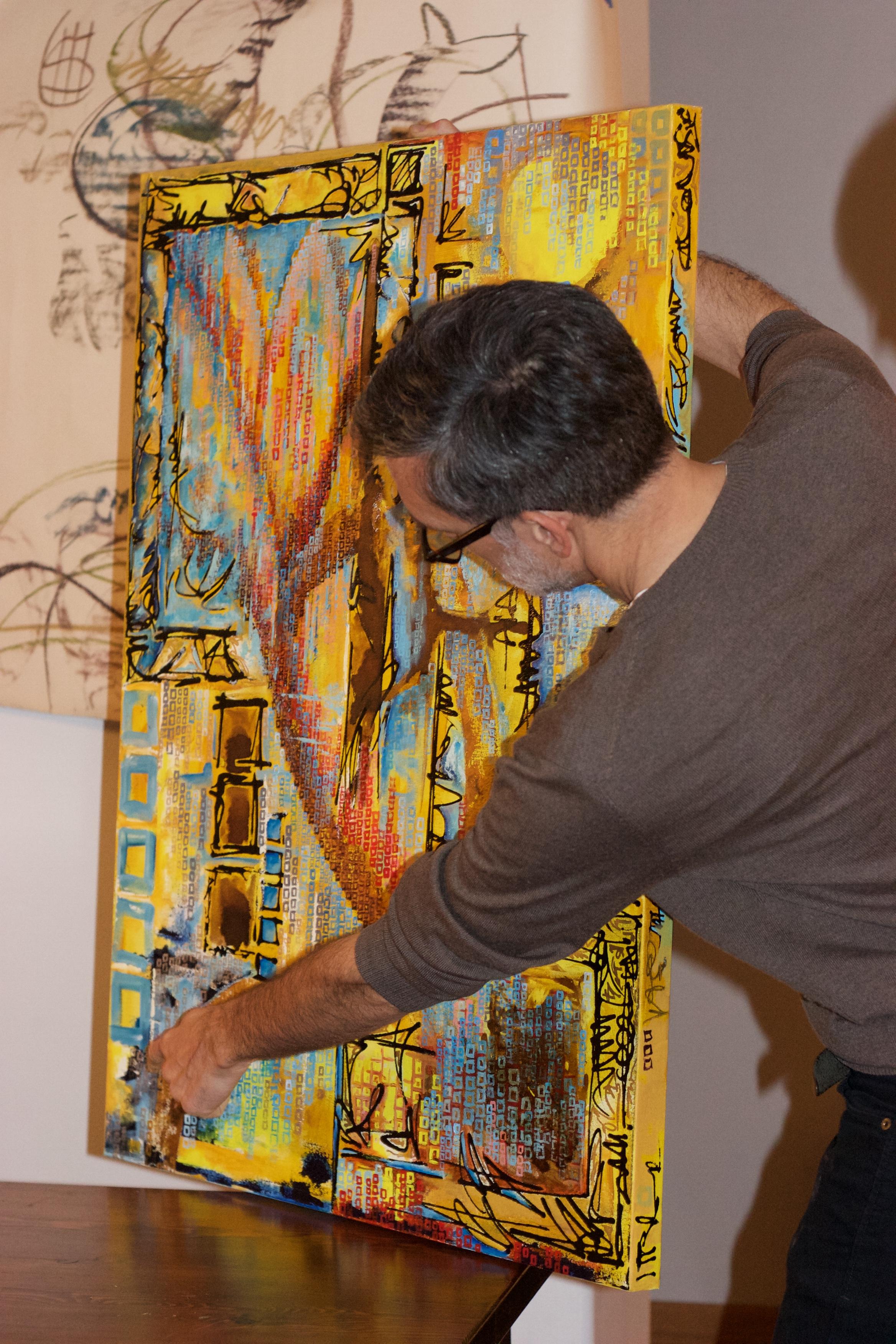 Scott Burnett illustrating a point via one of his paintings.