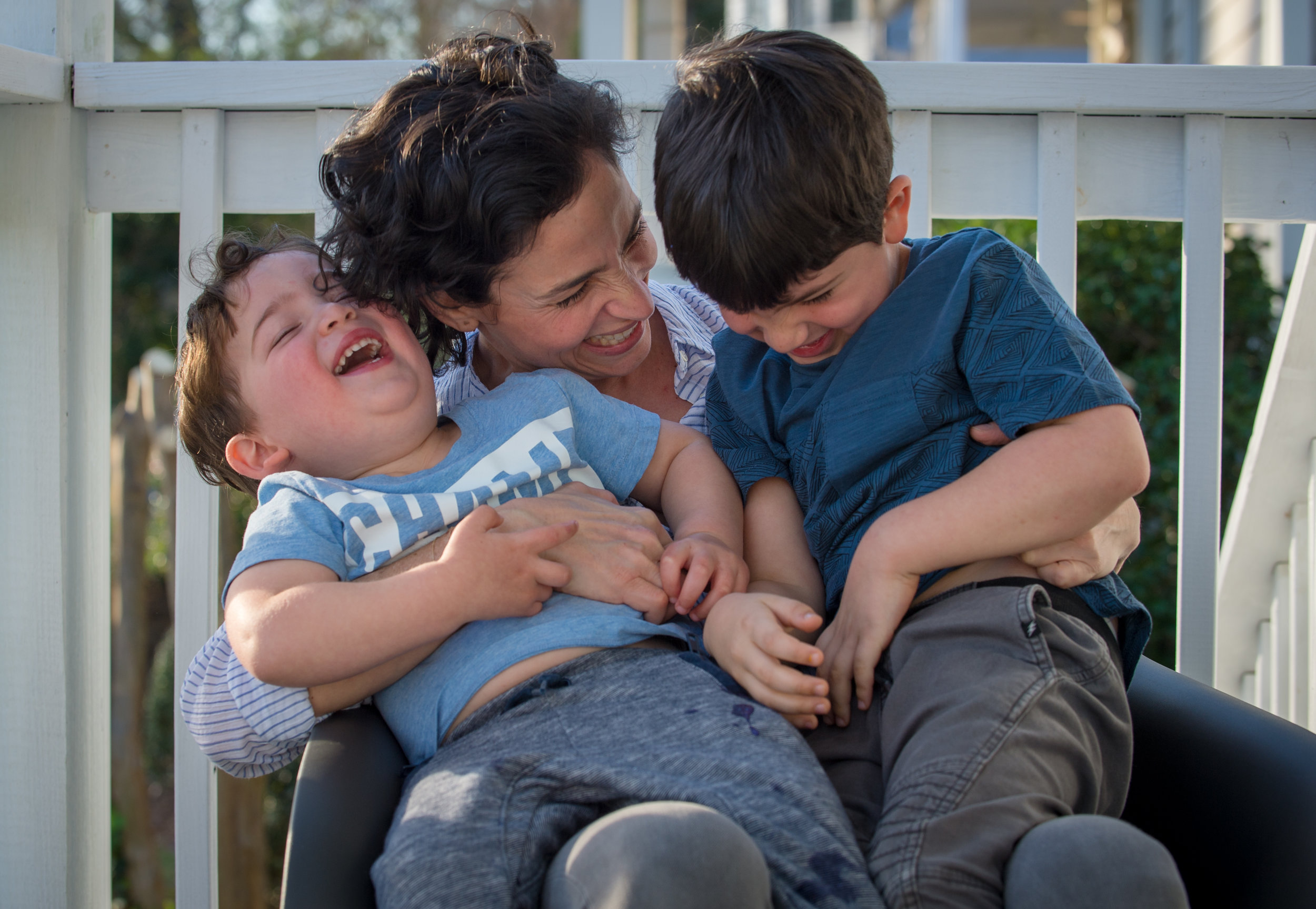 030418 DECATUR � Zoe Fishman Shacham spends time with sons (from left) Lev, 2, and Ari, 6, on the front porch of their Decatur home Sunday, March 3, 2018.