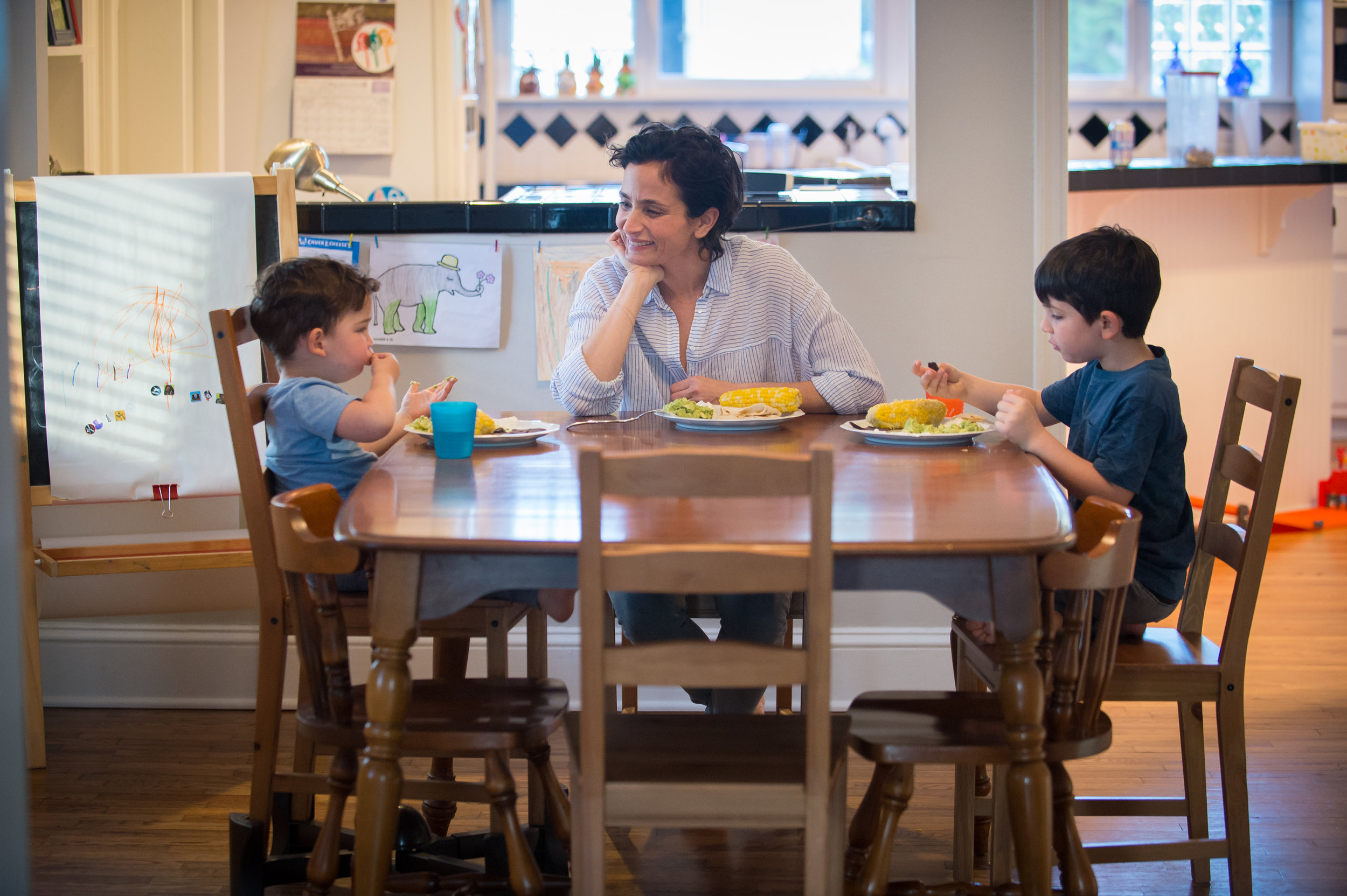 030418 DECATUR � Zoe Fishman Shacham (center) enjoys dinner with her sons (from left) Lev, 2, and Ari, 6, at their Decatur home Sunday, March 3, 2018.