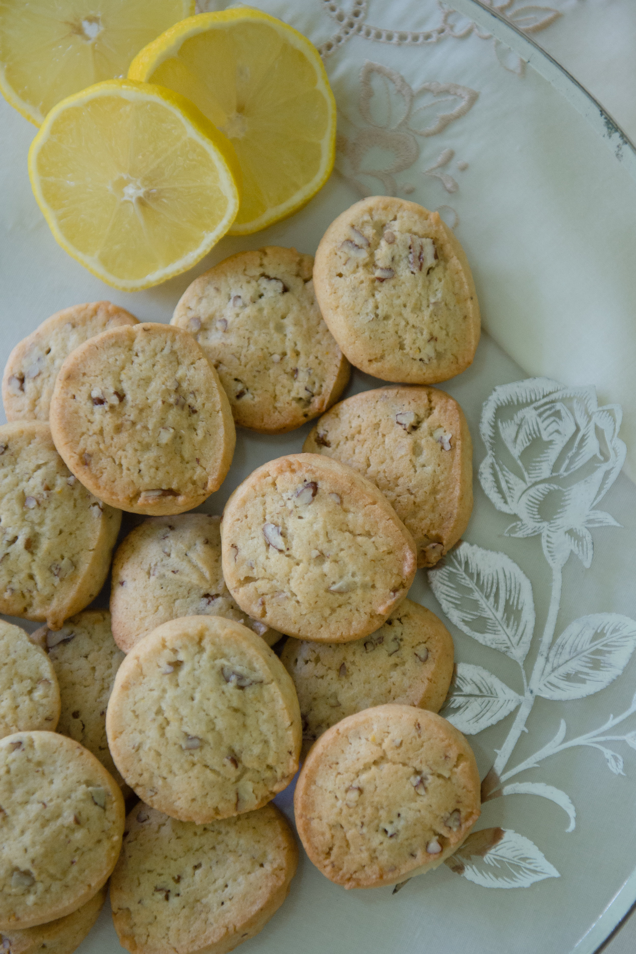 Lemon icebox cookies, made from a recipe that belonged to Lucille Burton, on a platter and with a linen napkin that both also belonged to Burton.
