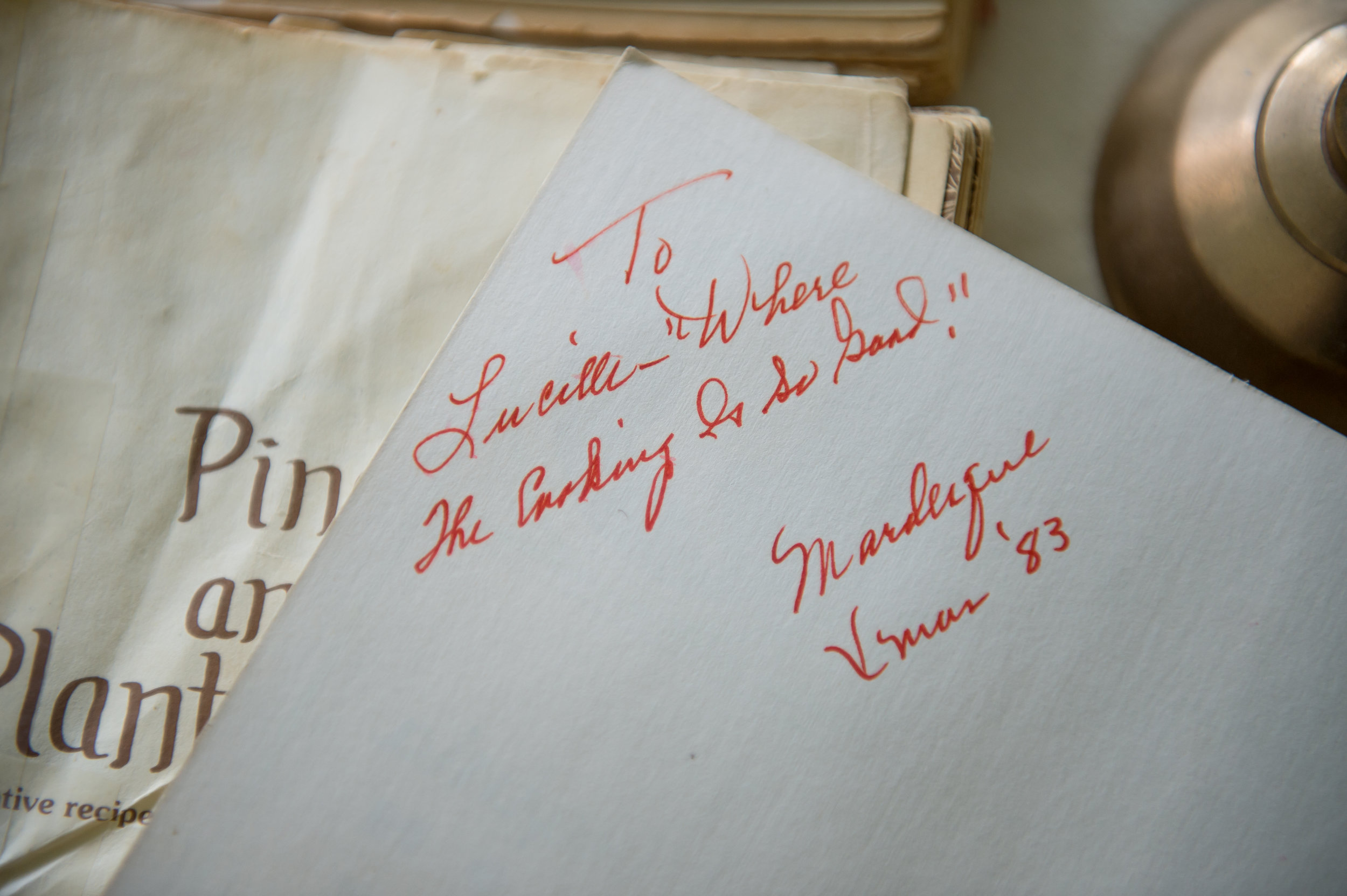 An inscription inside a cookbook once gifted to Lucille Burton, great aunt to Rosalind Bentley and mother to Bentley's second cousin Brenda Webb.